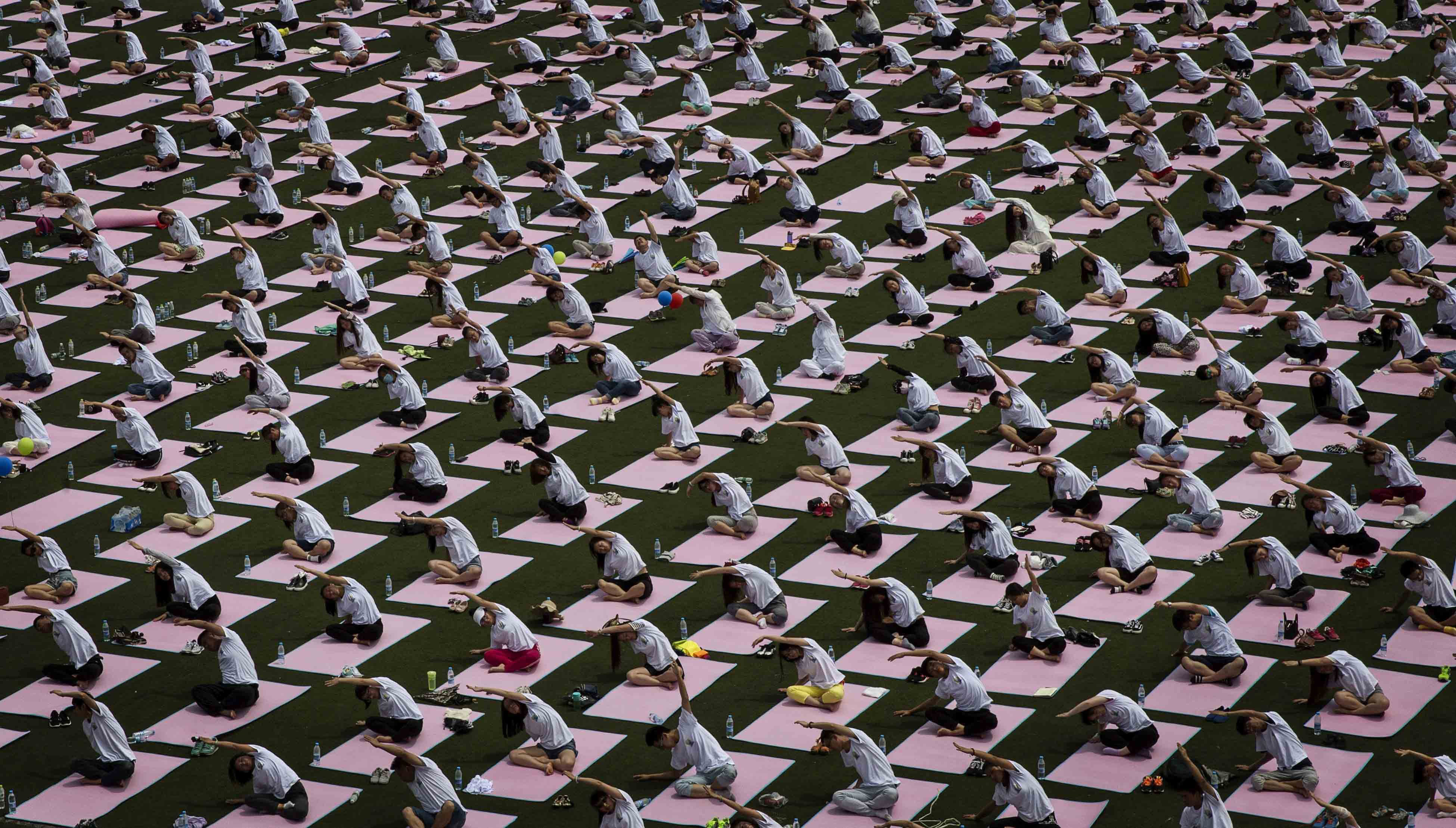 Chinese students from Geely University take part in a yoga workshop marking the International Day of Yoga at an event in Beijing sponsored by the Government of India on June 21, 2015.