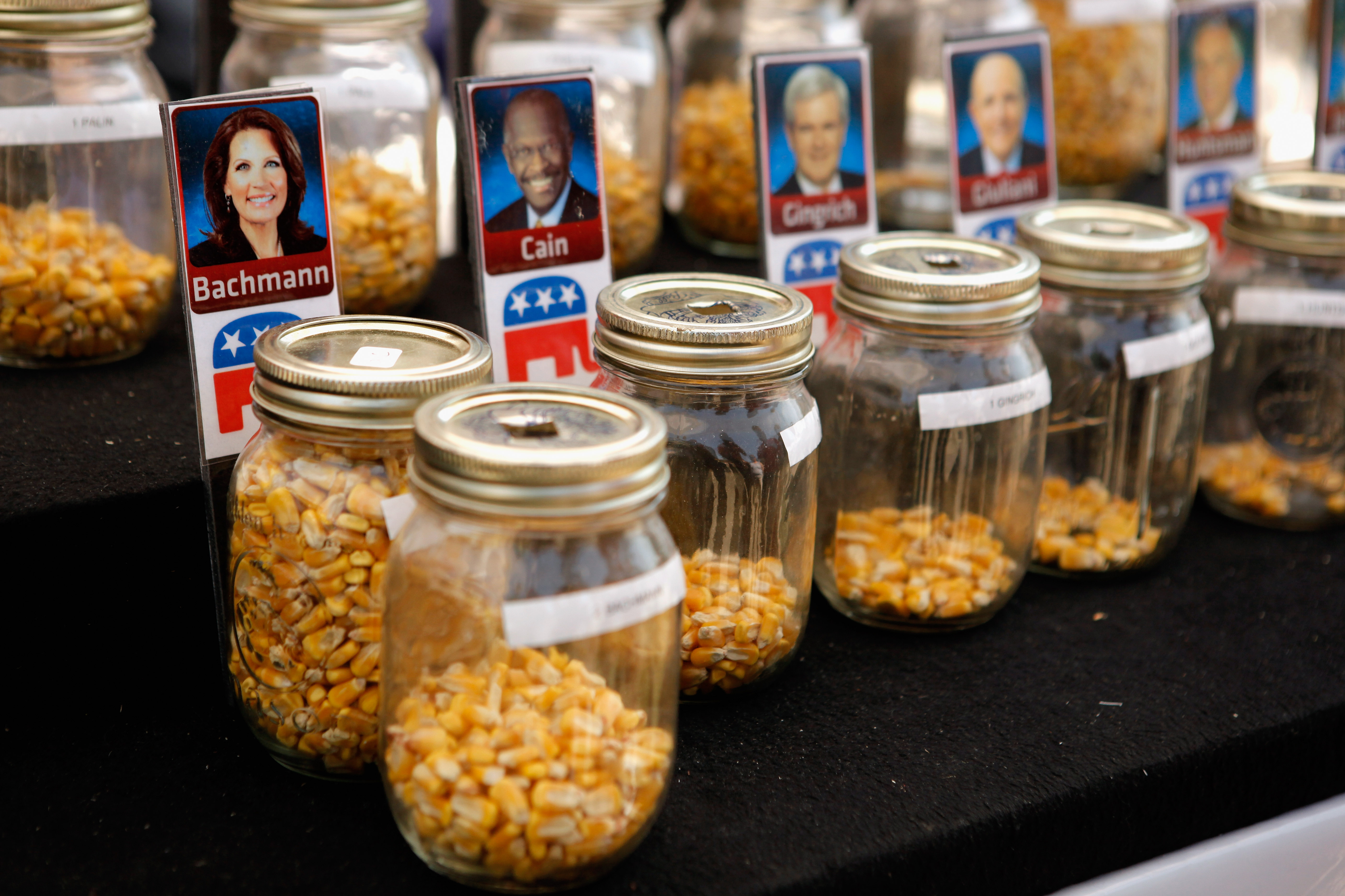 Fairgoers over the age of 18 are invited to drop one piece of corn into one of 14 jars with photos of their favorite Republican presidential candidate during the second day of the Iowa State Fair ahead of the Iowa Straw Poll on Aug. 12, 2011 in Des Moines, Iowa.