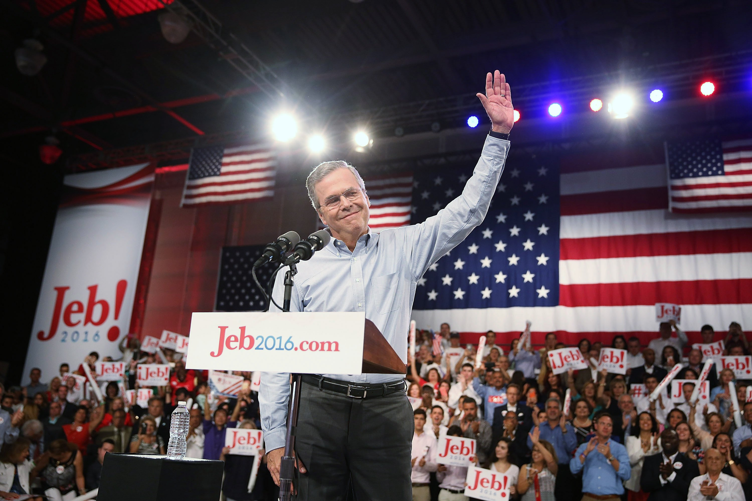 Former Florida Governor Jeb Bush waves on stage as he announces his candidacy for the Republican presidential nomination during an event at Miami-Dade College - Kendall Campus in Miami on June 15 , 2015.