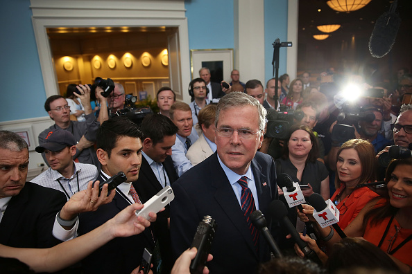 Former Florida Governor Jeb Bush and possible Republican presidential candidate speaks to the media after addressing the Rick Scott's Economic Growth Summit held at the Disney's Yacht and Beach Club Convention Center on June 2, 2015 in Orlando, Florida.