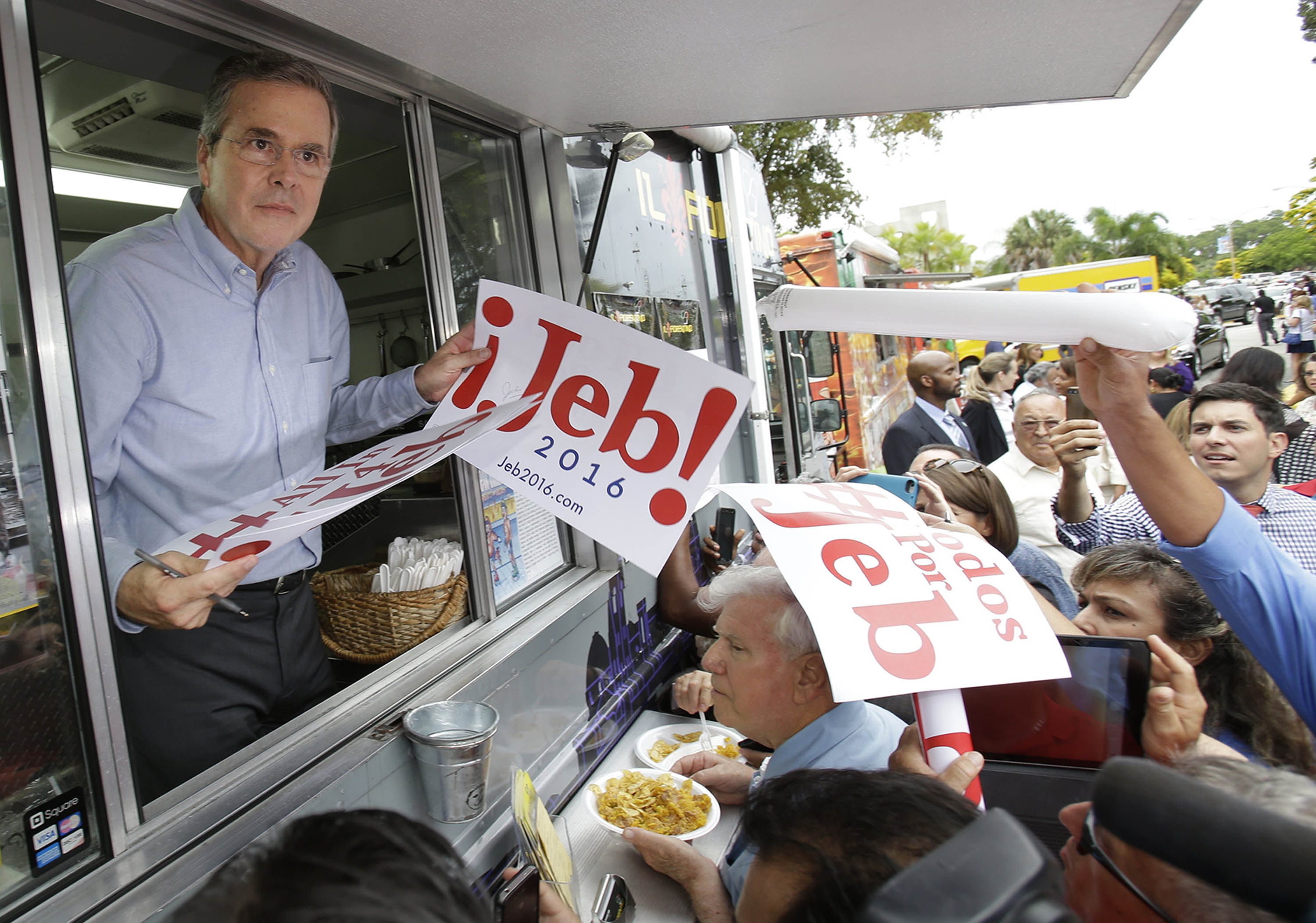 Jeb Bush, inside a food truck in Miami, signed autographs on June 15.