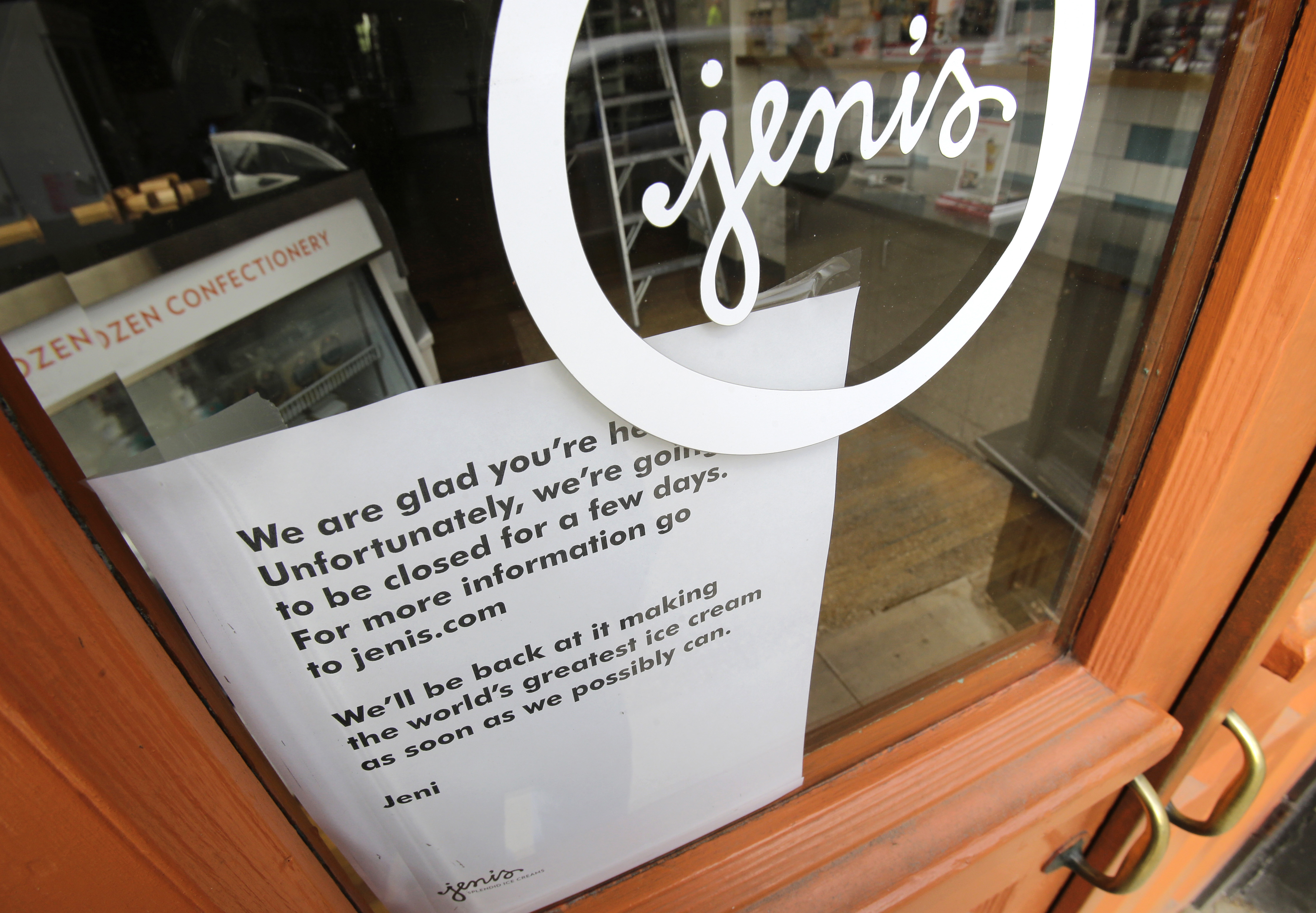 A sign on a window at a Jeni's Splendid Ice Creams states that the store is closed, in Chagrin Falls, Ohio, on April 24, 2015.