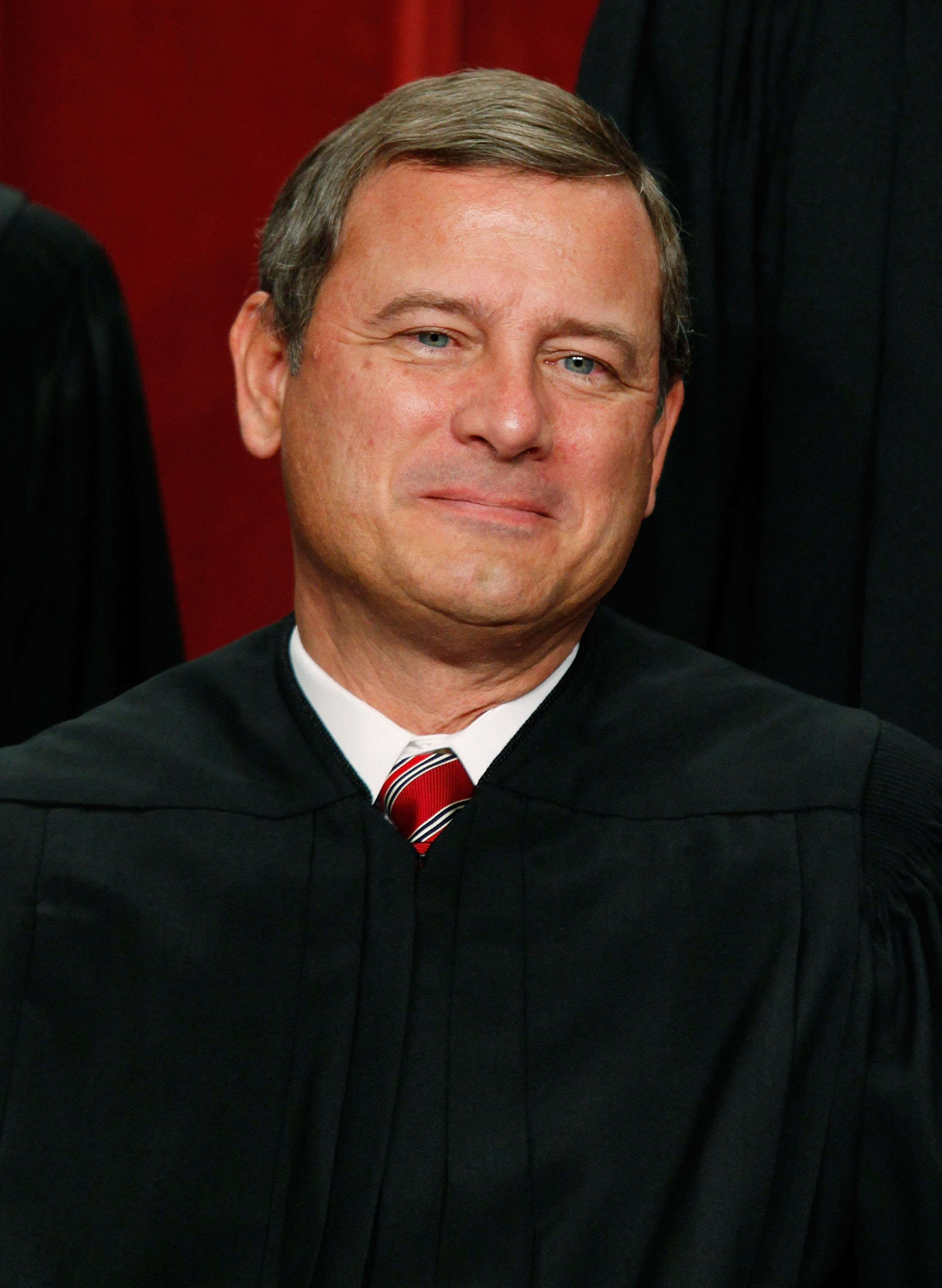 Chief Justice John G. Roberts poses for a group photograph at the Supreme Court building on Sept. 29, 2009 in Washington DC.