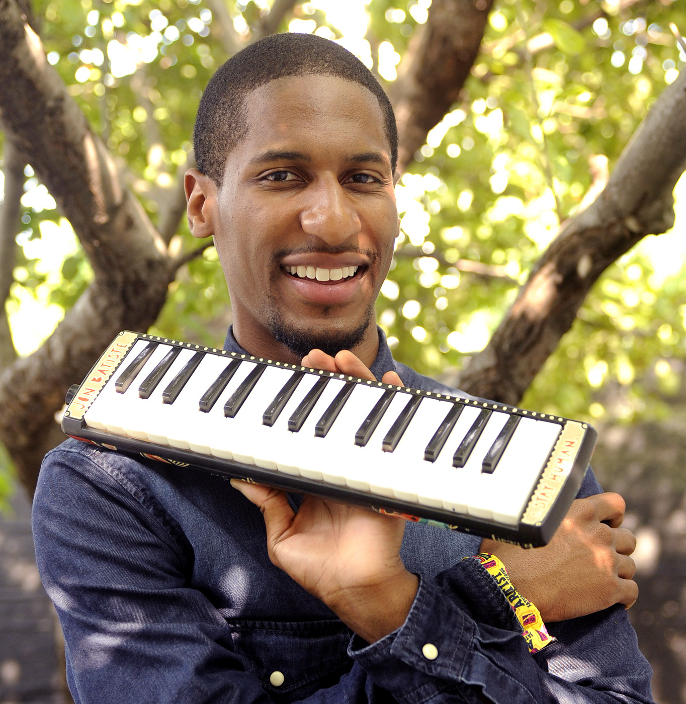 Jon Batiste poses at 2014 Lollapalooza at Grant Park on Aug. 2, 2014 in Chicago.