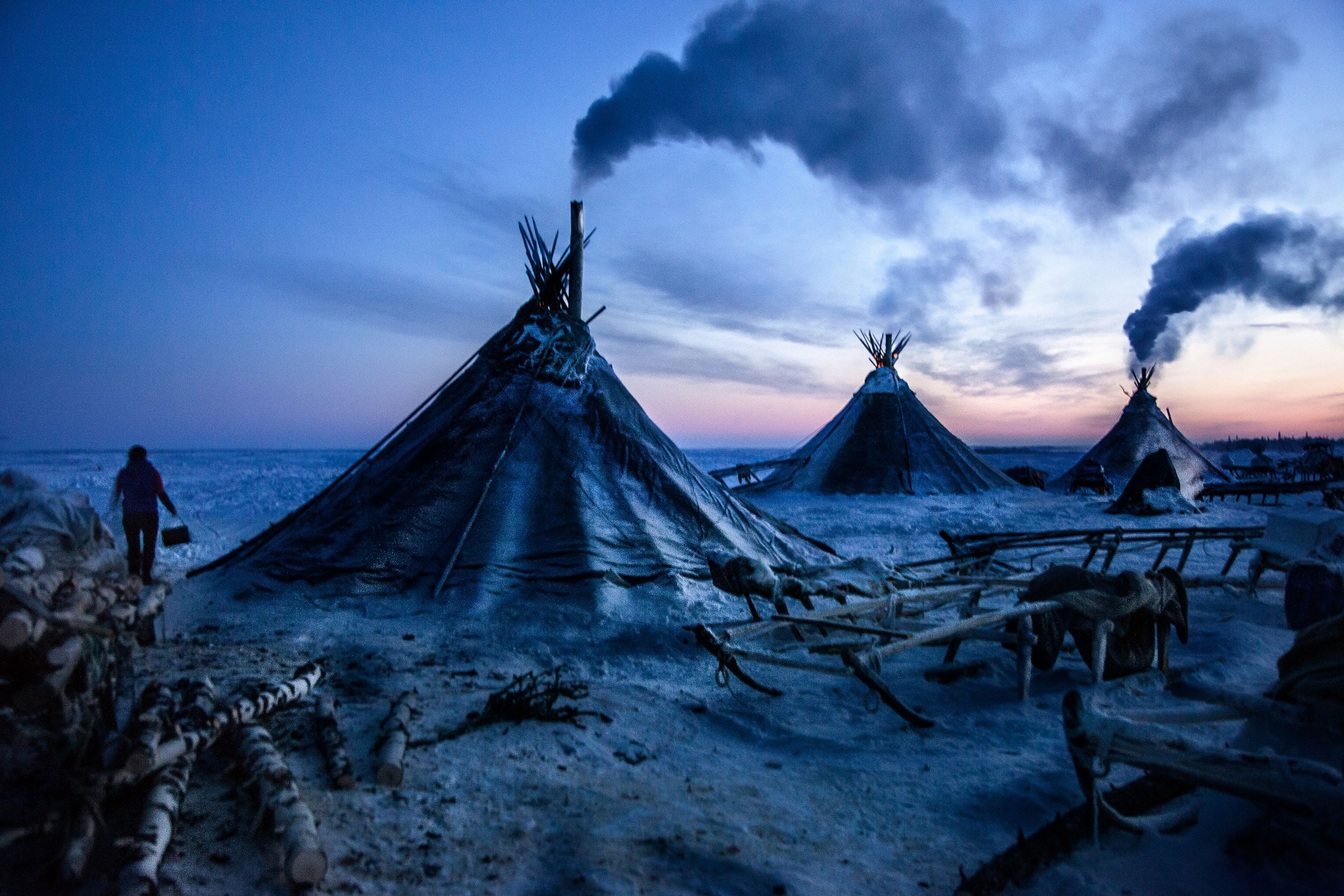 A colony of tents, or  chums , belonging to Nenets herders stand in the Arctic tundra in the Russian Nenets Autonomous Region. The culture of the indigenous people of the Russian Arctic eroded under Soviet collectivization and now their land is endangered due to modern oil and gas exploration, February 2011.