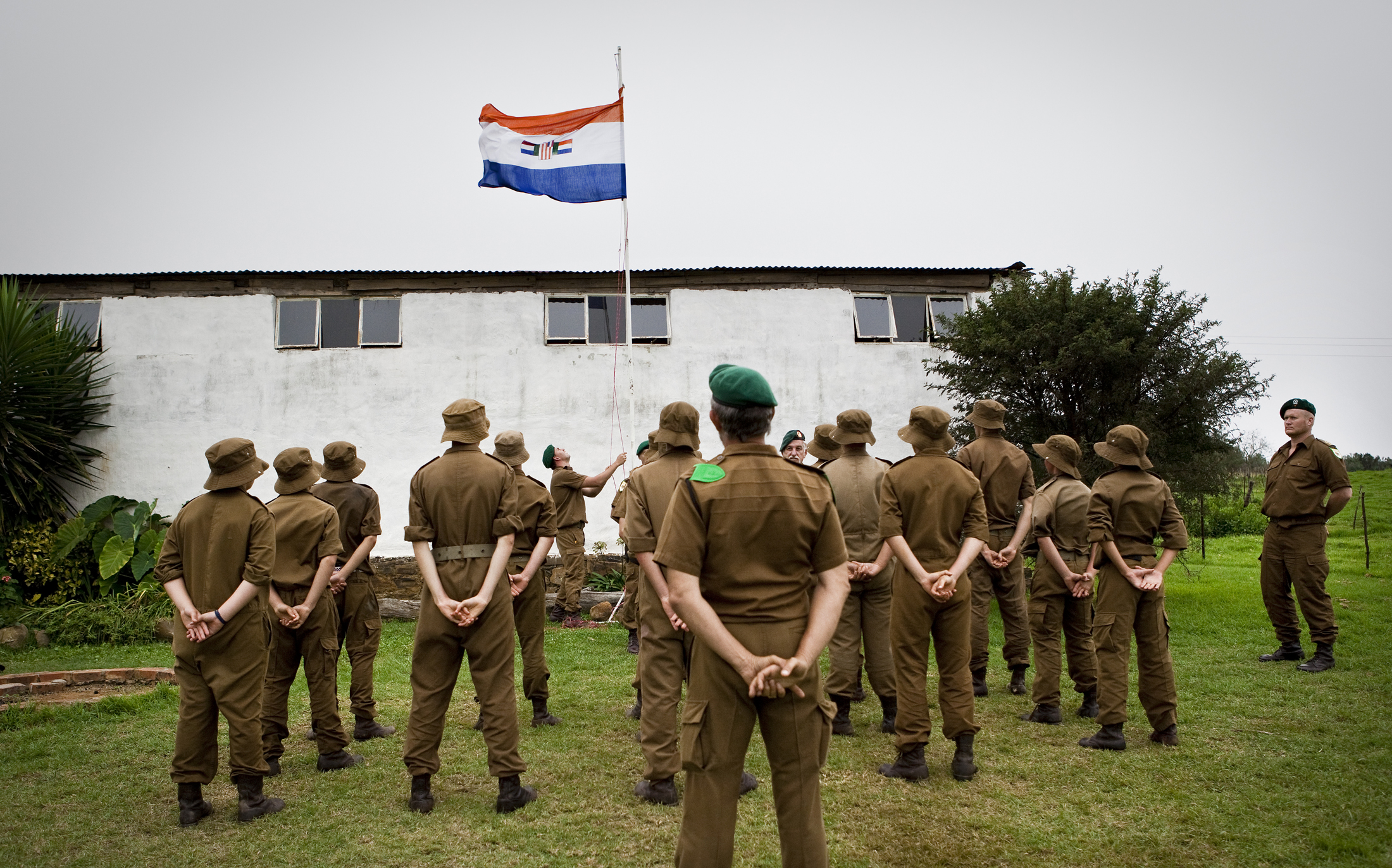 The boys at the Kommandokorps camp sing the old South African national anthem, an anthem in Afrikaans, while hoisting the flag during the camp.