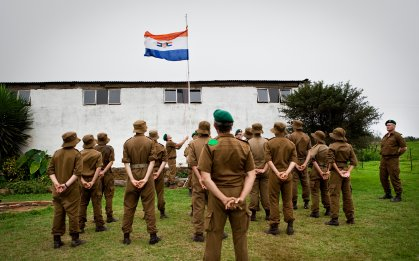 CAROLINA - The boys at the kommandokorps camp sing the old South African national anthem, an anthem in Afrikaans, while hoisting the flag during the camp. ILVY NJIOKIKTJIEN