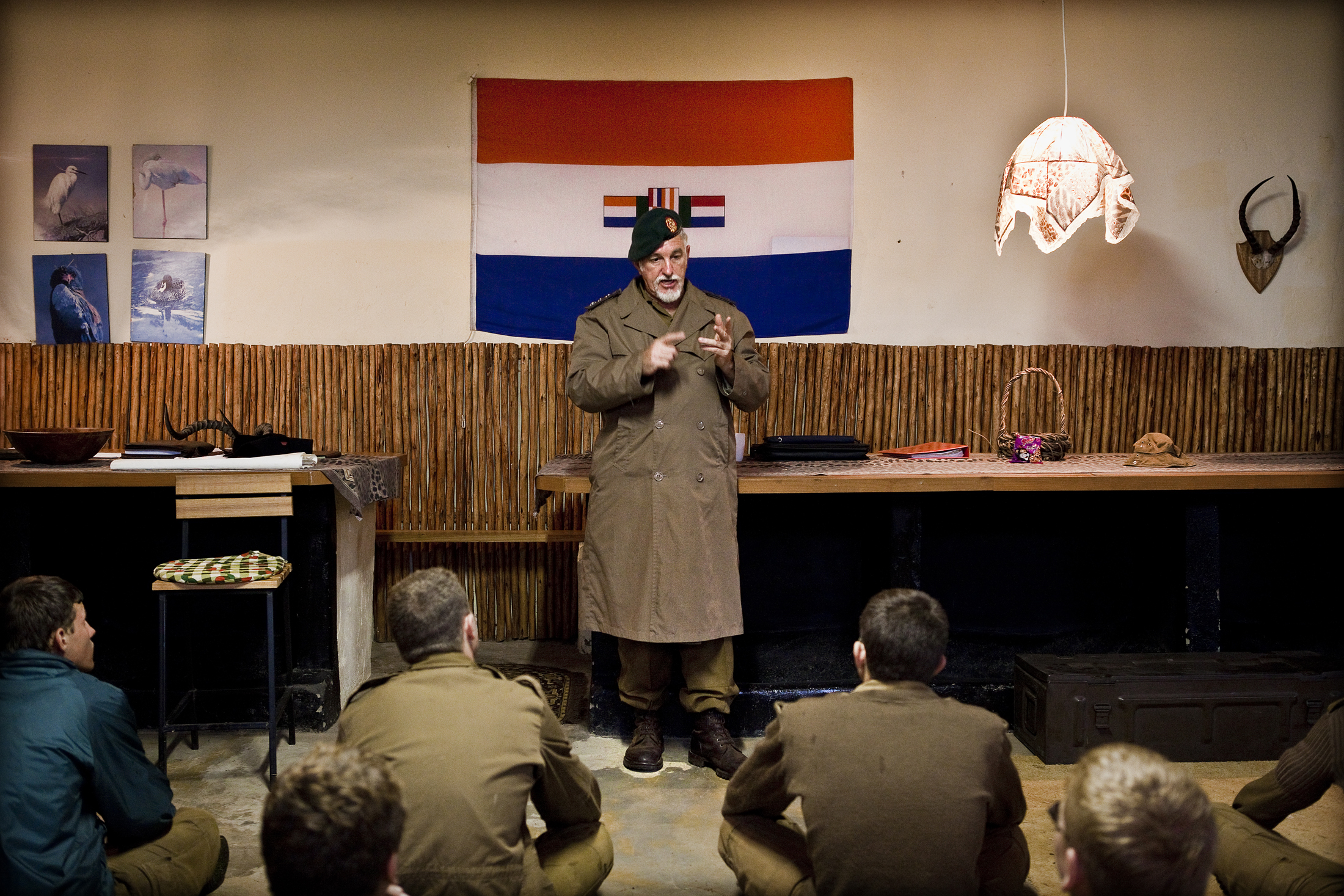 Self-acclaimed colonel and leader of the camp, Franz Jooste during one of his lectures at night at the kommandokorps camp.  Aside from the Aborigines in Australia, the African black is the most underdeveloped, barbaric member of the human race on Earth,  he tells the boys during one of his lectures.
