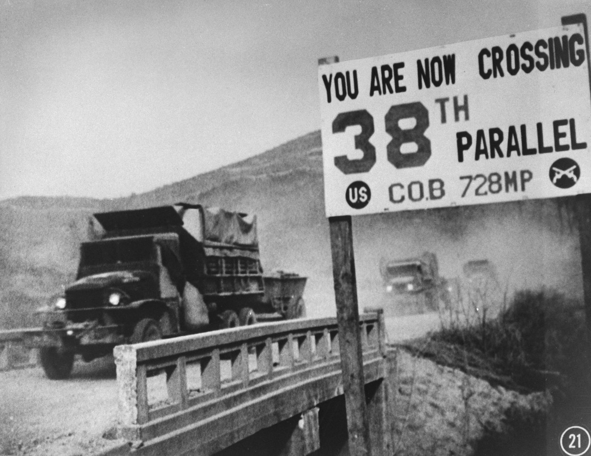 UN forces' transport vehicles recrossing the 38th Parallel as they withdraw from Pyongyang in 1950