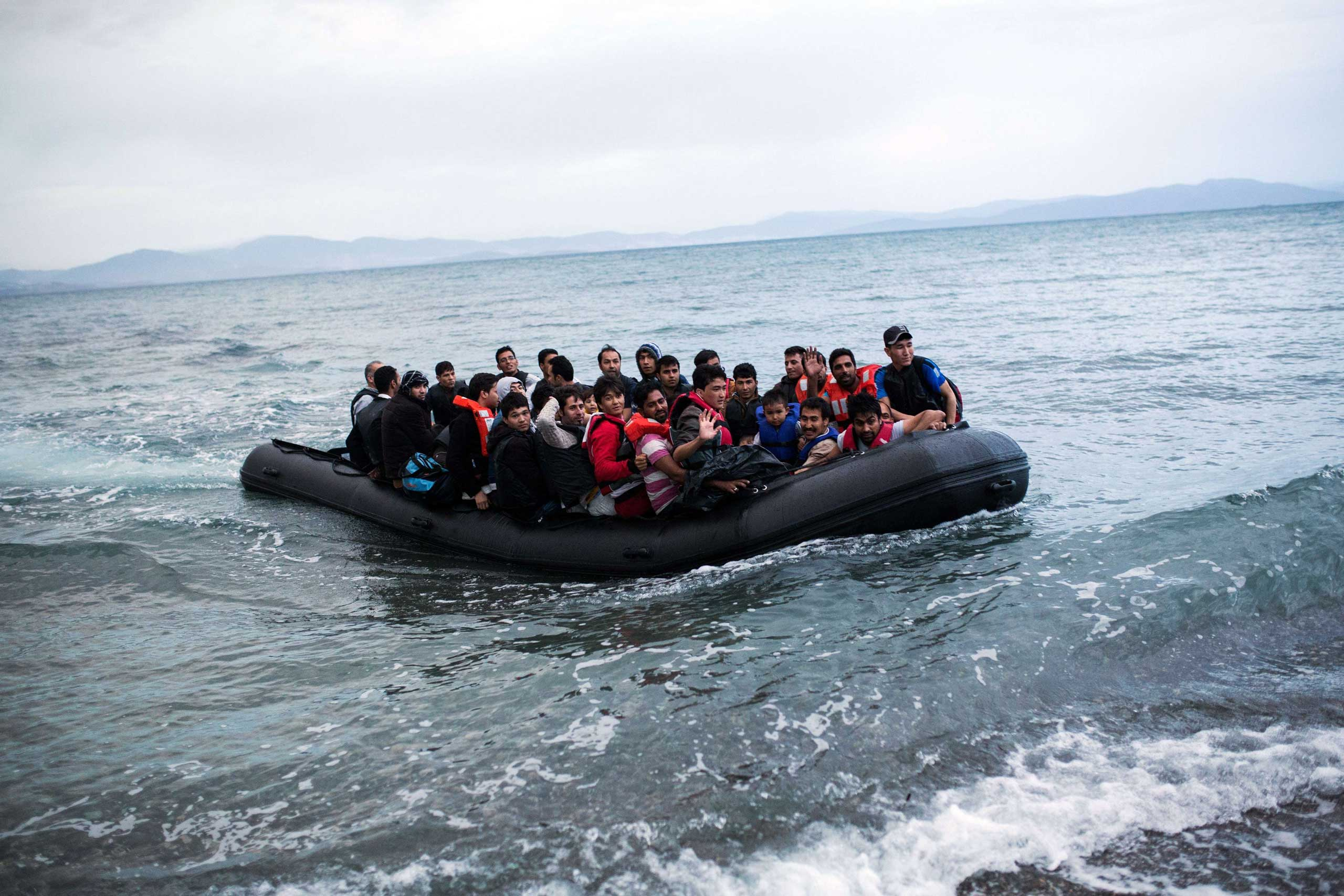 A dinghy overcrowded with Afghan migrants arrives on the Greek island of Kos, after crossing a part of the Aegean Sea between Turkey and Greece, on May 27, 2015.