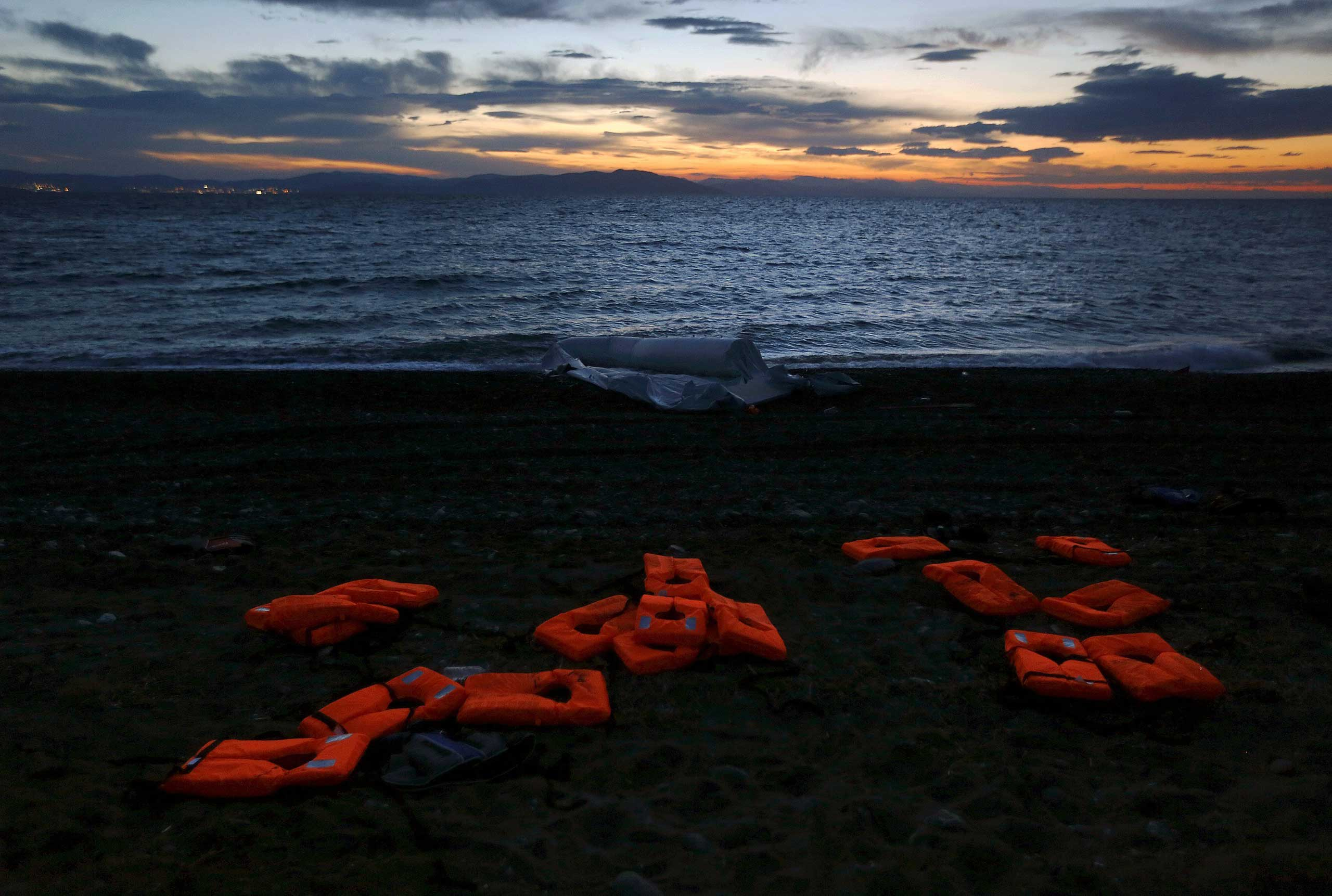 Life vests and a deflated dinghy are seen on a beach on the Greek island of Kos, following the arrival of Afghan immigrants, on May 30, 2015.
