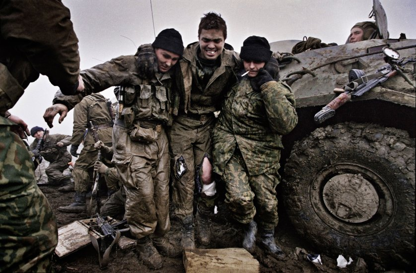 Russian marines help a wounded fellow soldier after being caught in an ambush near Tsentaroy, Checnya, Dec. 1999. Yuri Kozyrev—NOOR