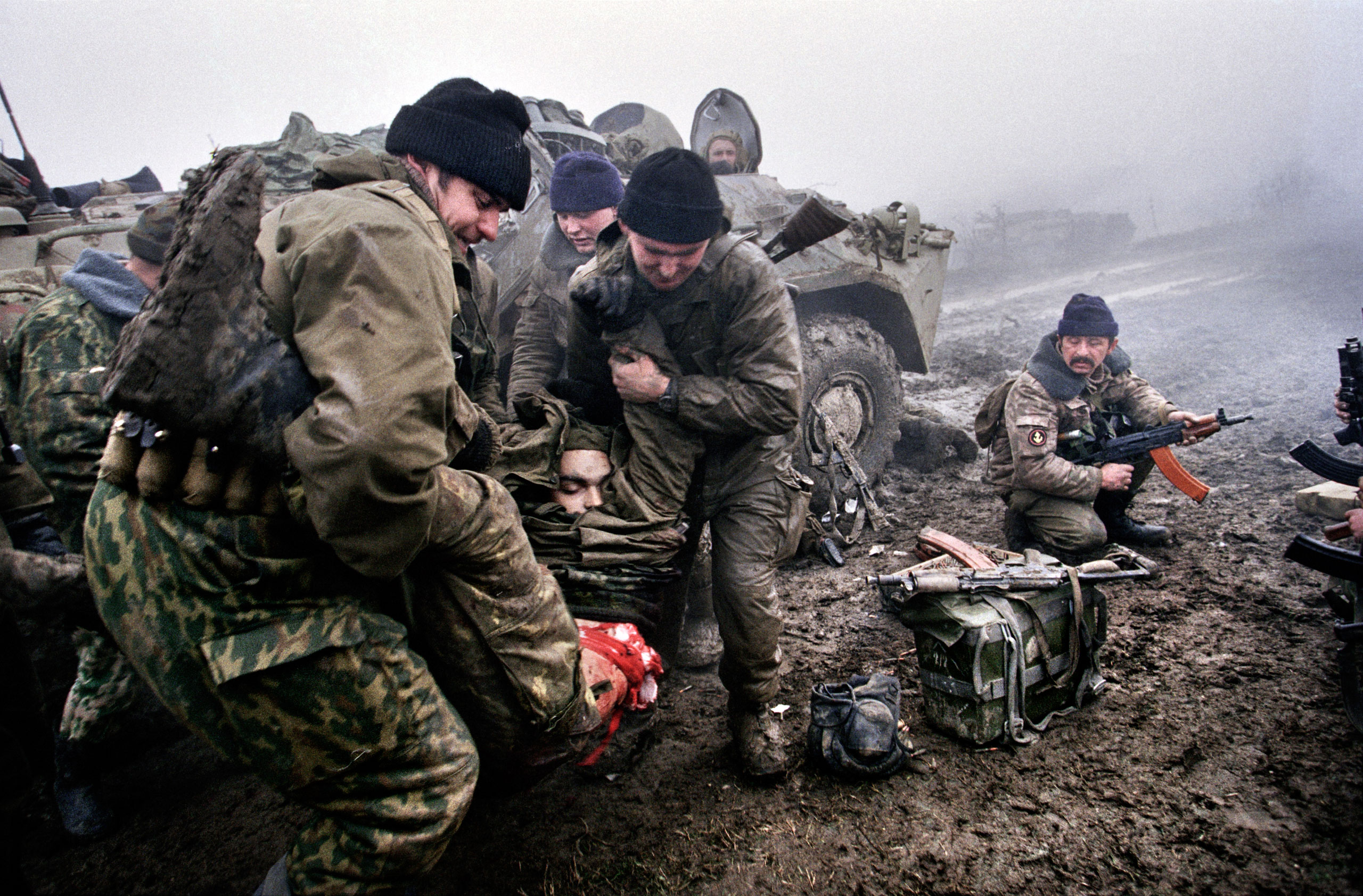 Marines carry a dead comrade during fighting in Tsentaroy, Chechnya, December 1999. In September of that year, Russian forces began military action against Chechen rebels.