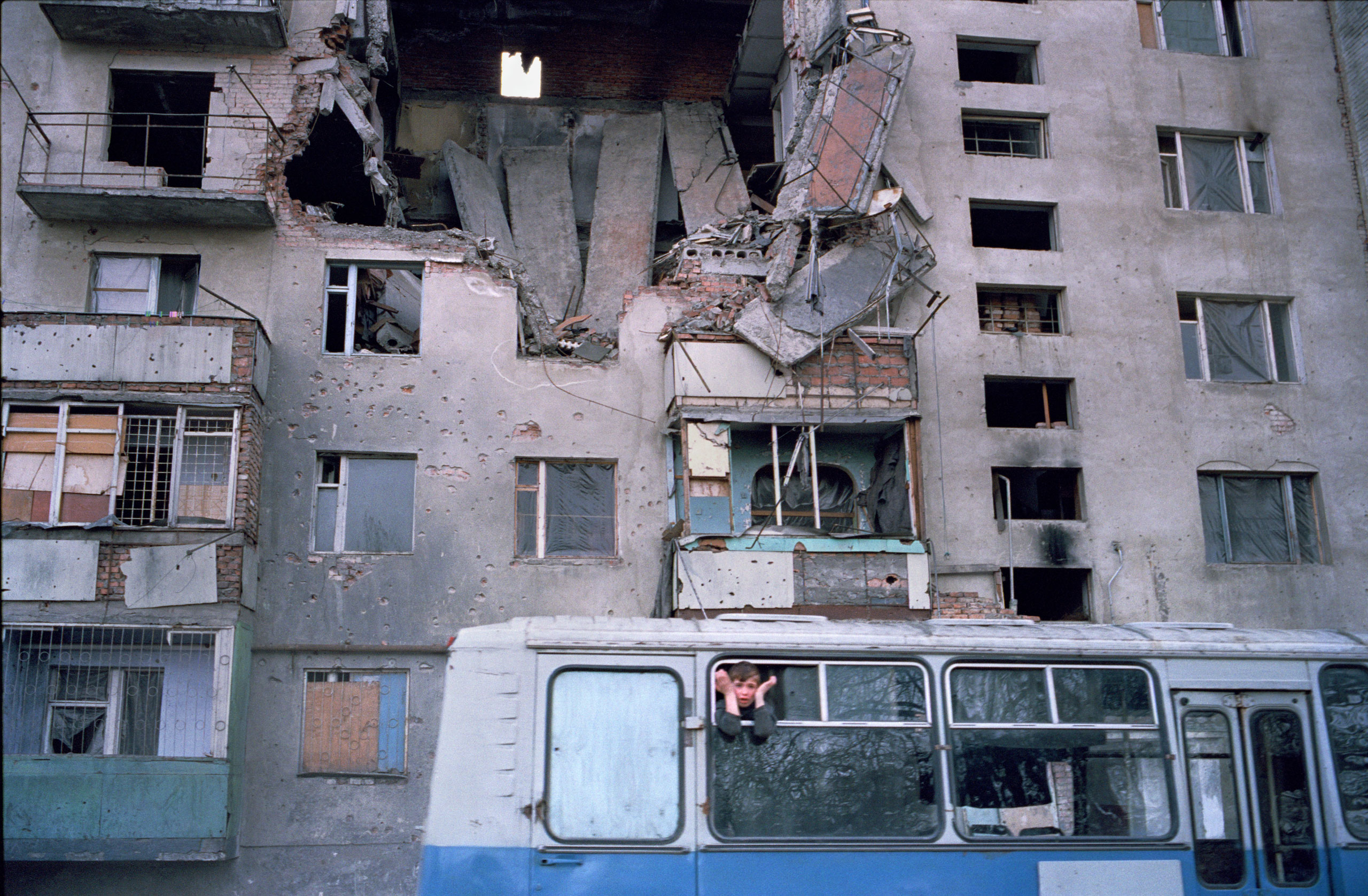 Outside the destroyed House of the Blind in Grozny, Chechnya, March  2002.