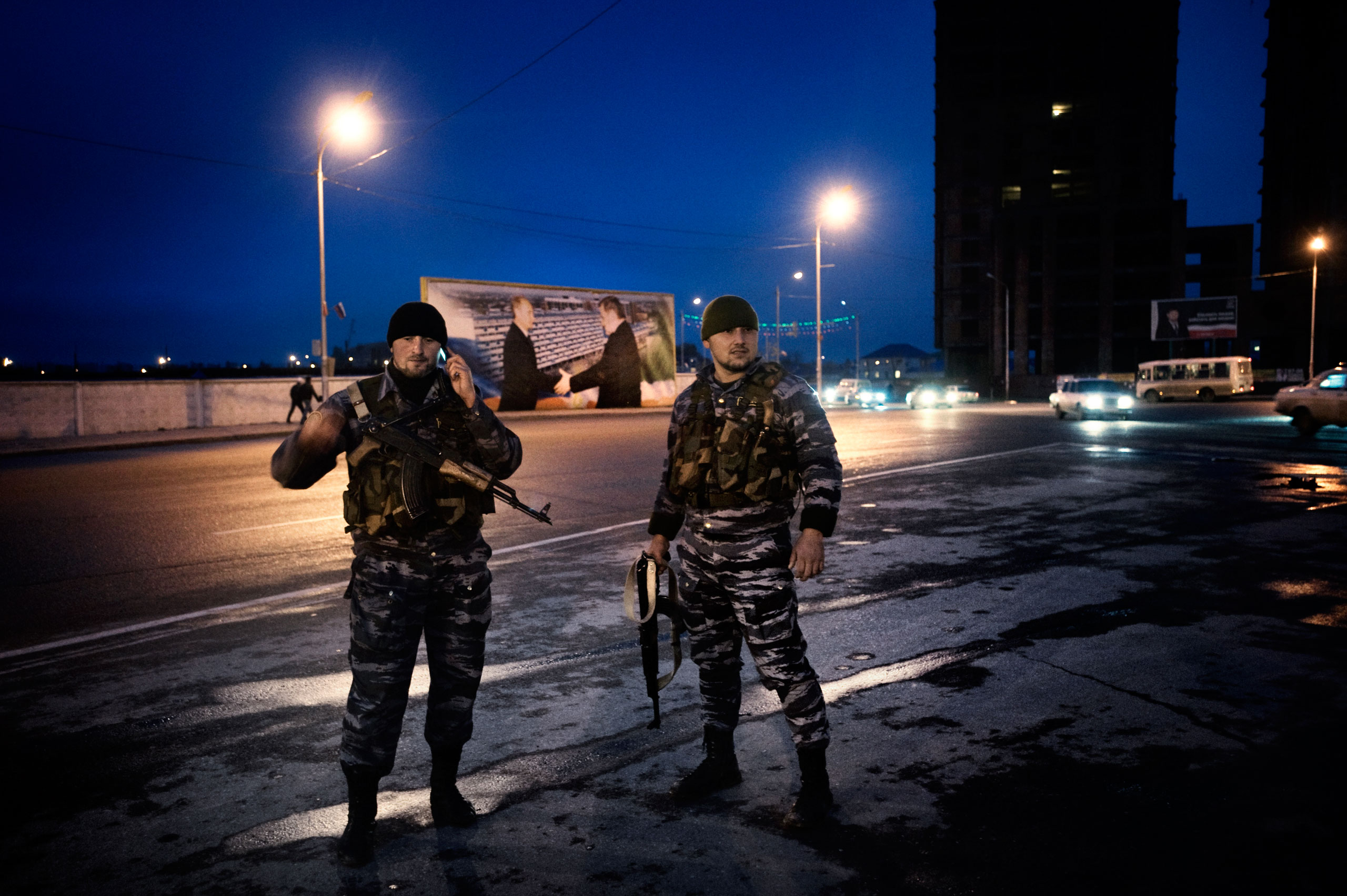 Chechen policemen, often targeted by rebels, guard a Grozny street with a billboard of Russian President Vladimir Putin and slain President Akhmad Kadyrov in the background. By 2009, Russia lifted martial law in Chechnya, and allowed the locals to police the region themselves, thereby succeeding in making faithful servants of some of Russia's most determined enemies, November 2009.