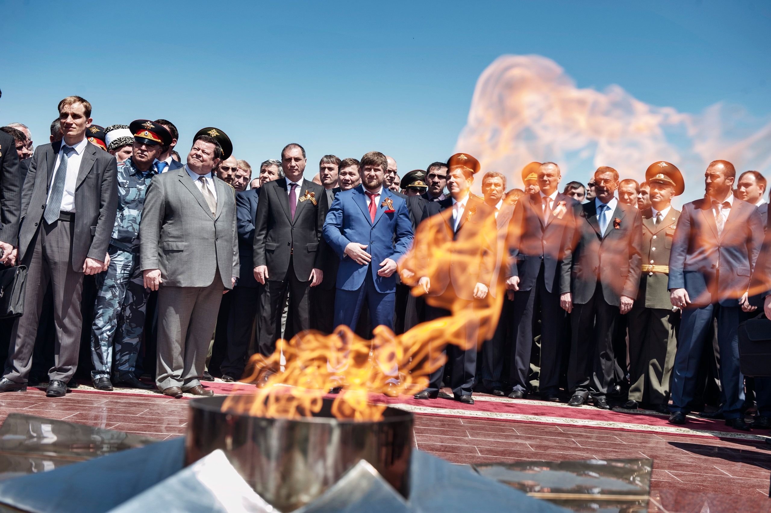 Chechen leader Ramzan Kadyrov, center, along with Russian and Chechen officials, attend a ceremony commemorating the Soviet victory in World War II, Grozny, Chechnya,  May 2010.