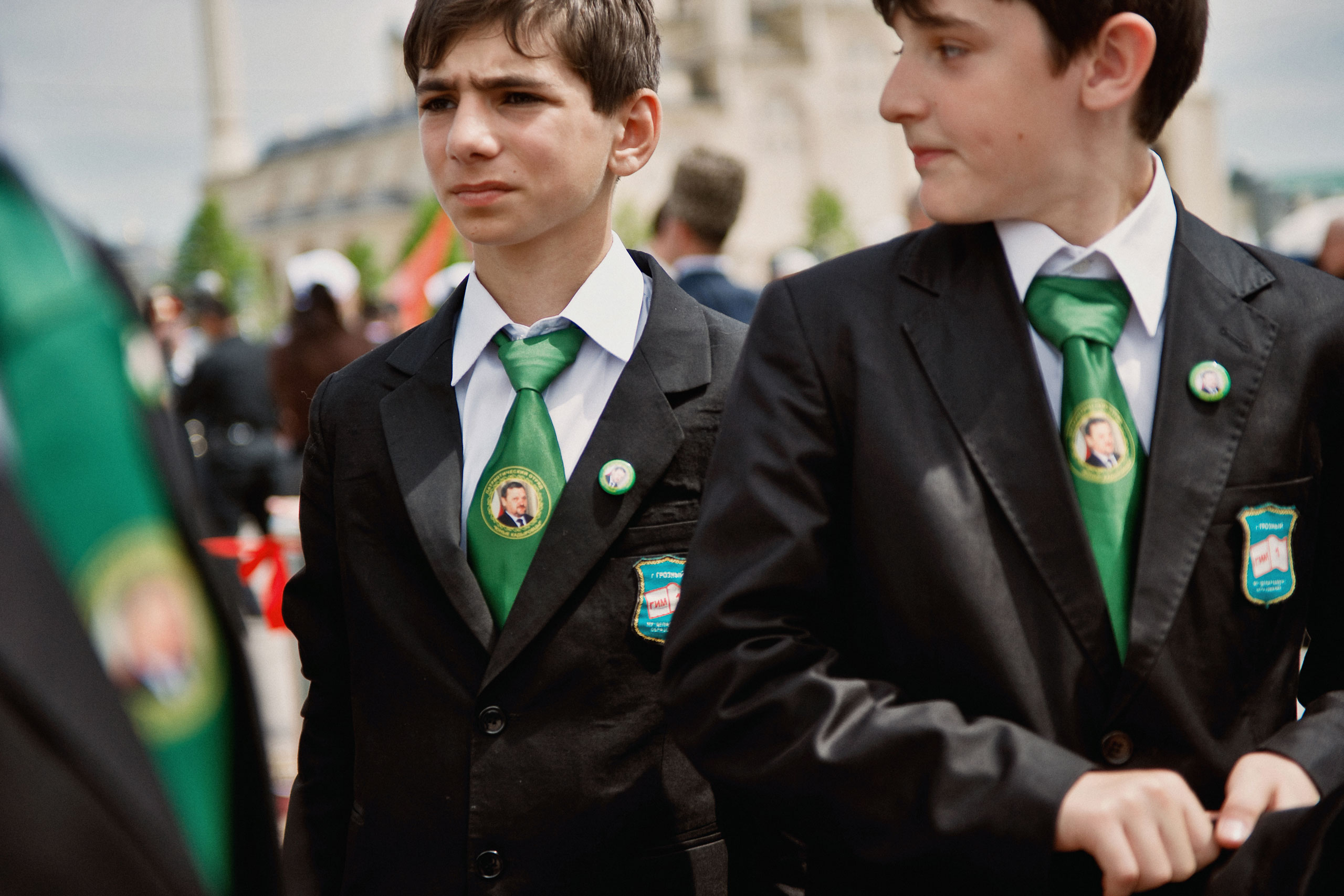 Chechen students wear ties picturing their leader Akhmad Kadyrov, at a WWII Victory Day Parade in Grozny, Chechnya, May 2010.