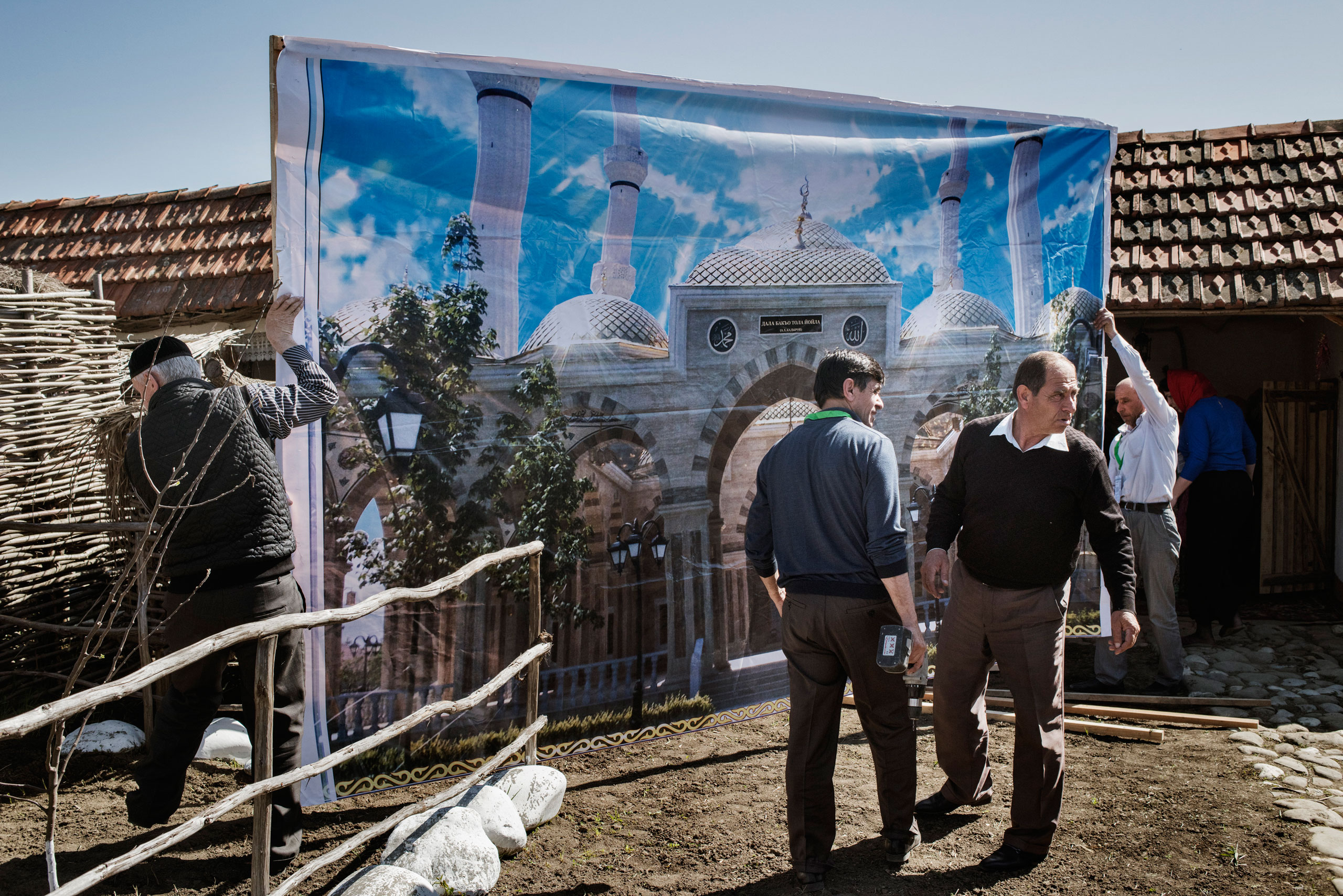 Workers set up their stand at a cultural festival near the town of Shali, Chechnya, April 2015.
