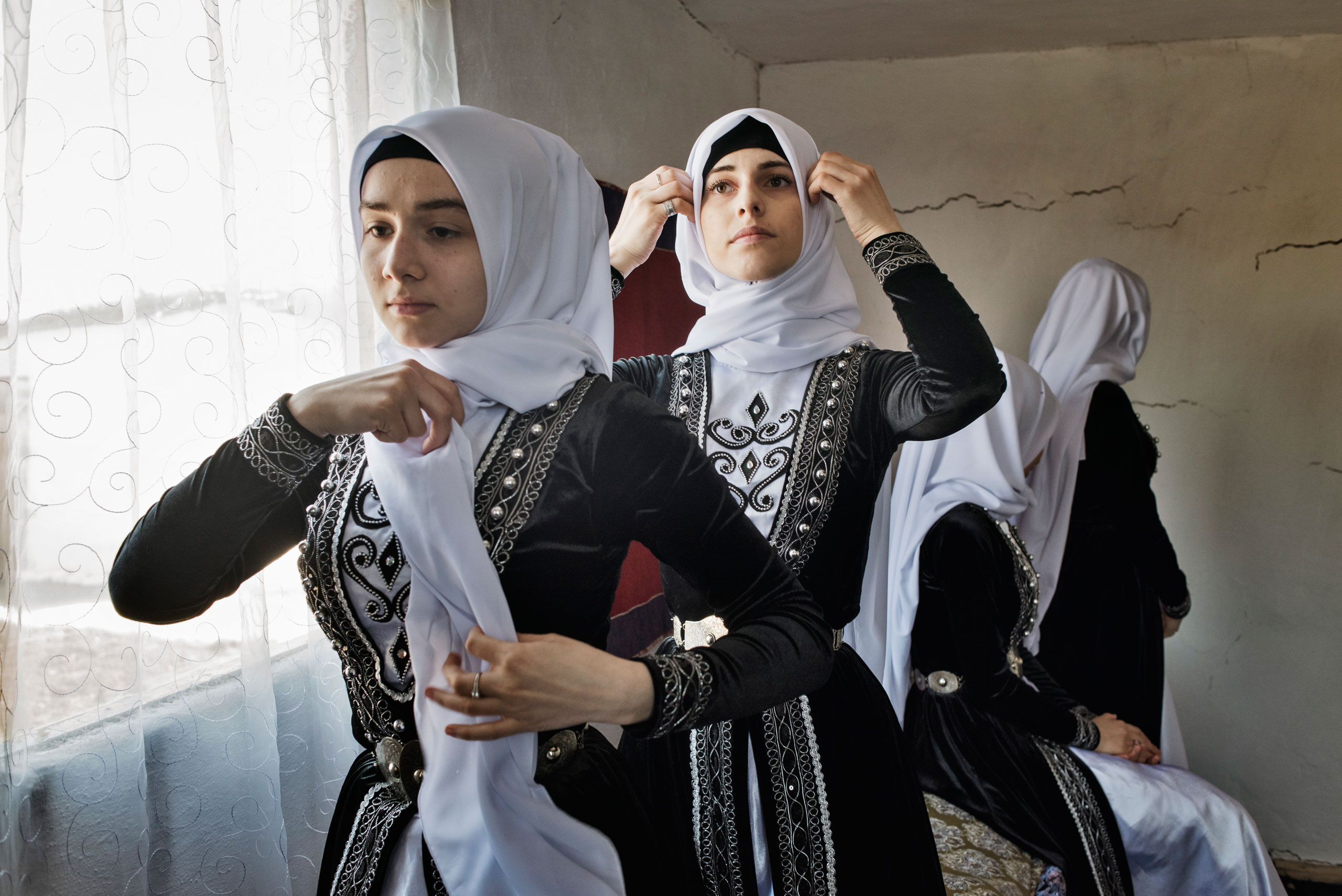 Young women in Chechnya await the arrival of Chechen leader Ramzan Kadyrov at a folk festival near the town of Shali, Chechnya, April 2015.