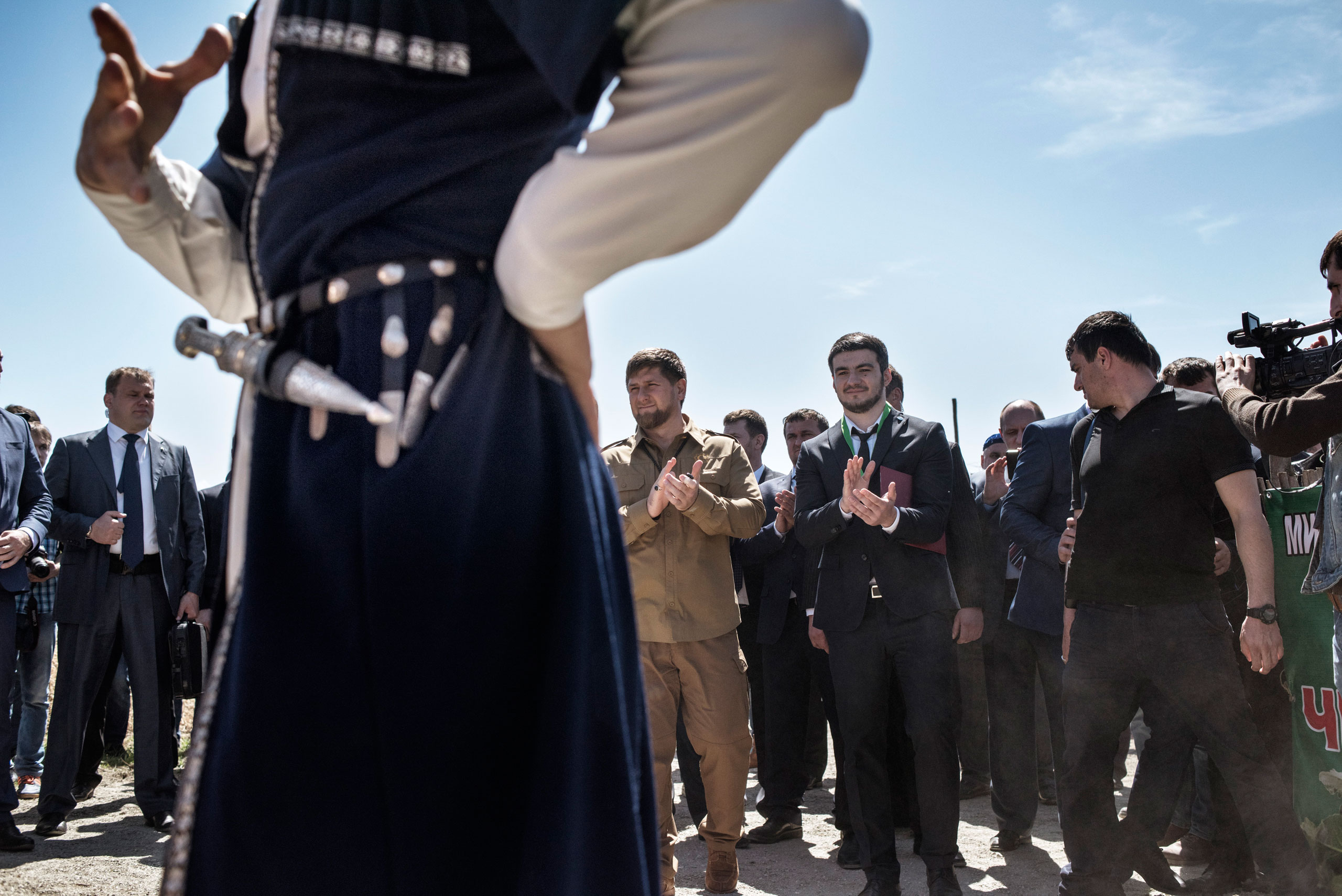 Traditional Chechen folk dancers perform for senior Russian and Chechen officials at a cultural festival near the town of Shali, Chechnya, April 2015.