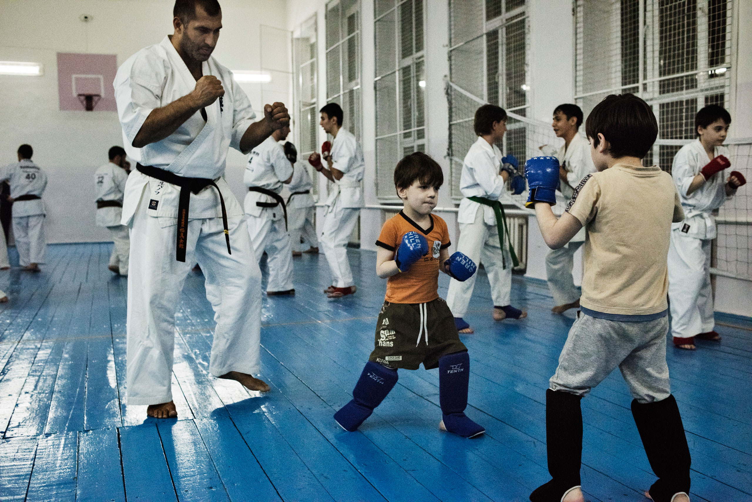 """Lechi Kurbanov, a world champion in karate and undefeated professional kickboxer, instructs students in karate at a gym in Grozny, Chechnya. """"Discipline is in our blood,"""" he says. """"We can do anything if our leader puts us on the path to do it."""" His best students go on to serve in some branches of the armed forces, April 2015."""