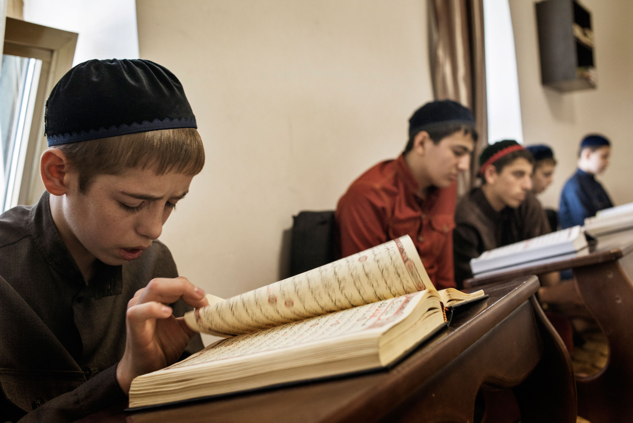 Boys study to become hafiz, or reciters of the Koran at a boarding school in Grozny, Chechnya. Reared                               on principles of fealty and self-sacrifice, many graduates are recruited to Kadyrov's security forces, April 2015.