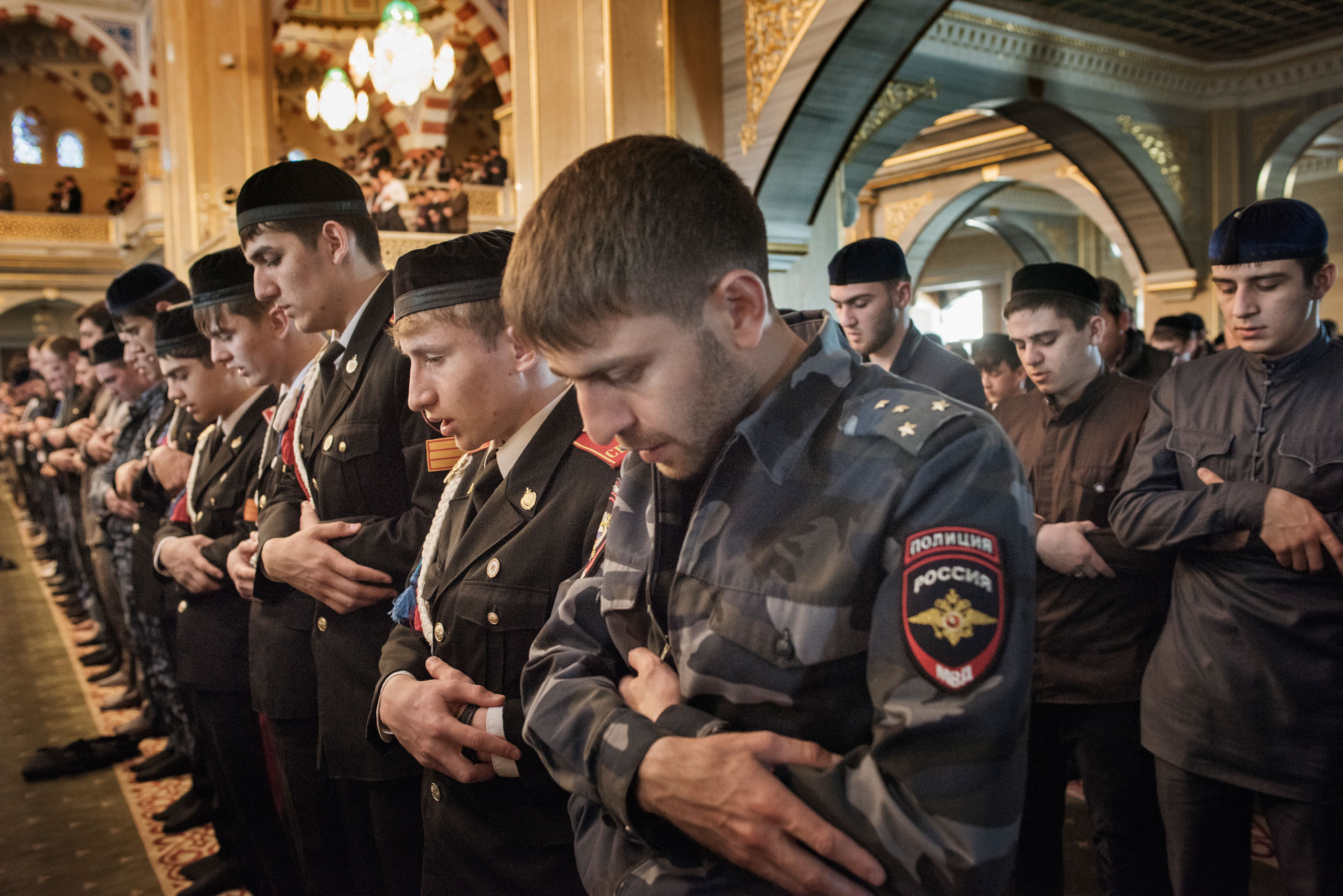 Chechen police officers and students of the prestigious Suvorov Police Academy in Chechnya attend Friday prayers at the central mosque in the regional capital of Grozny, April  2015.