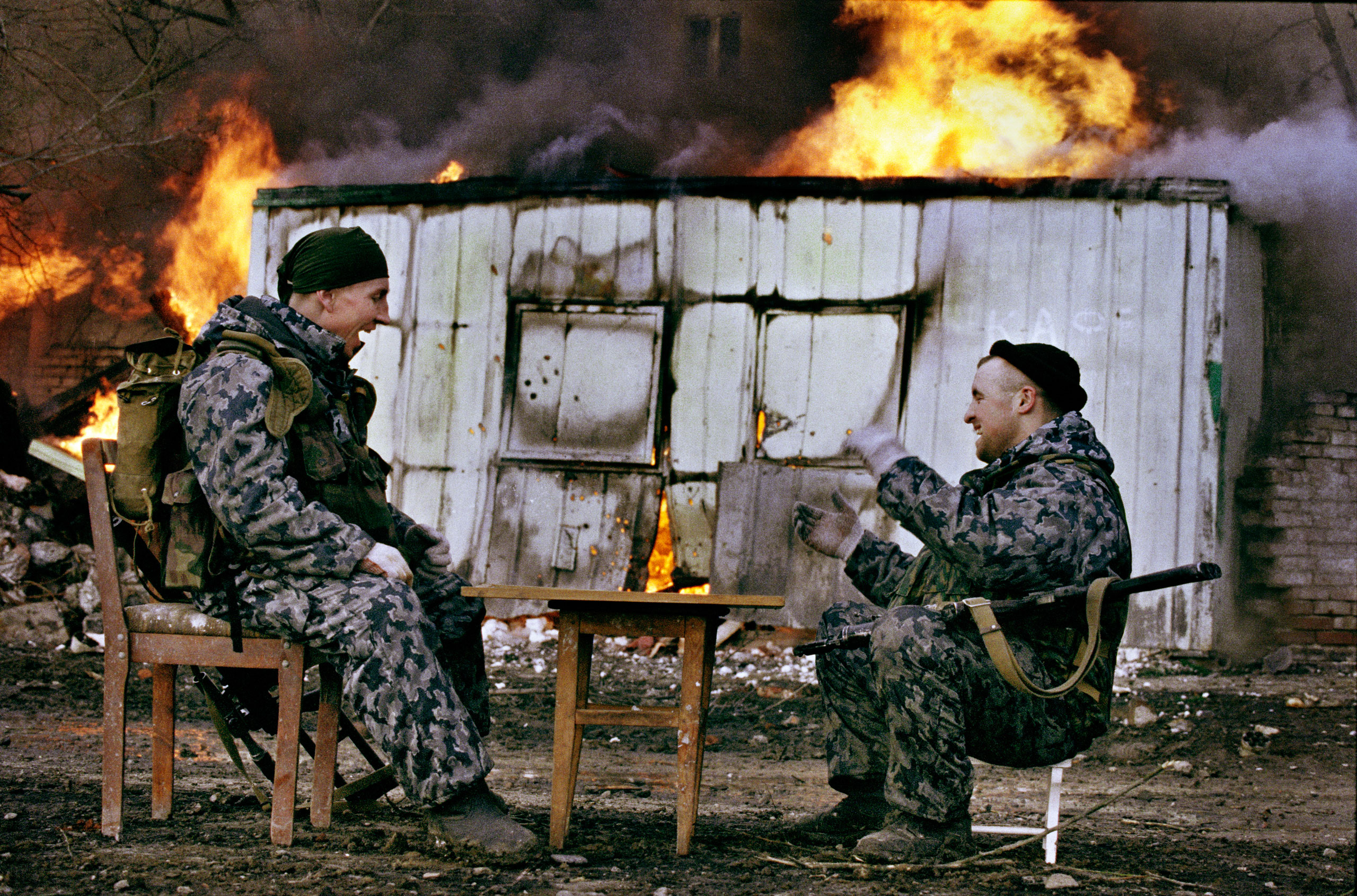 Fighters from the Russian militia special forces play a game in the destroyed city of Grozny, Chechnya, January, 2000.