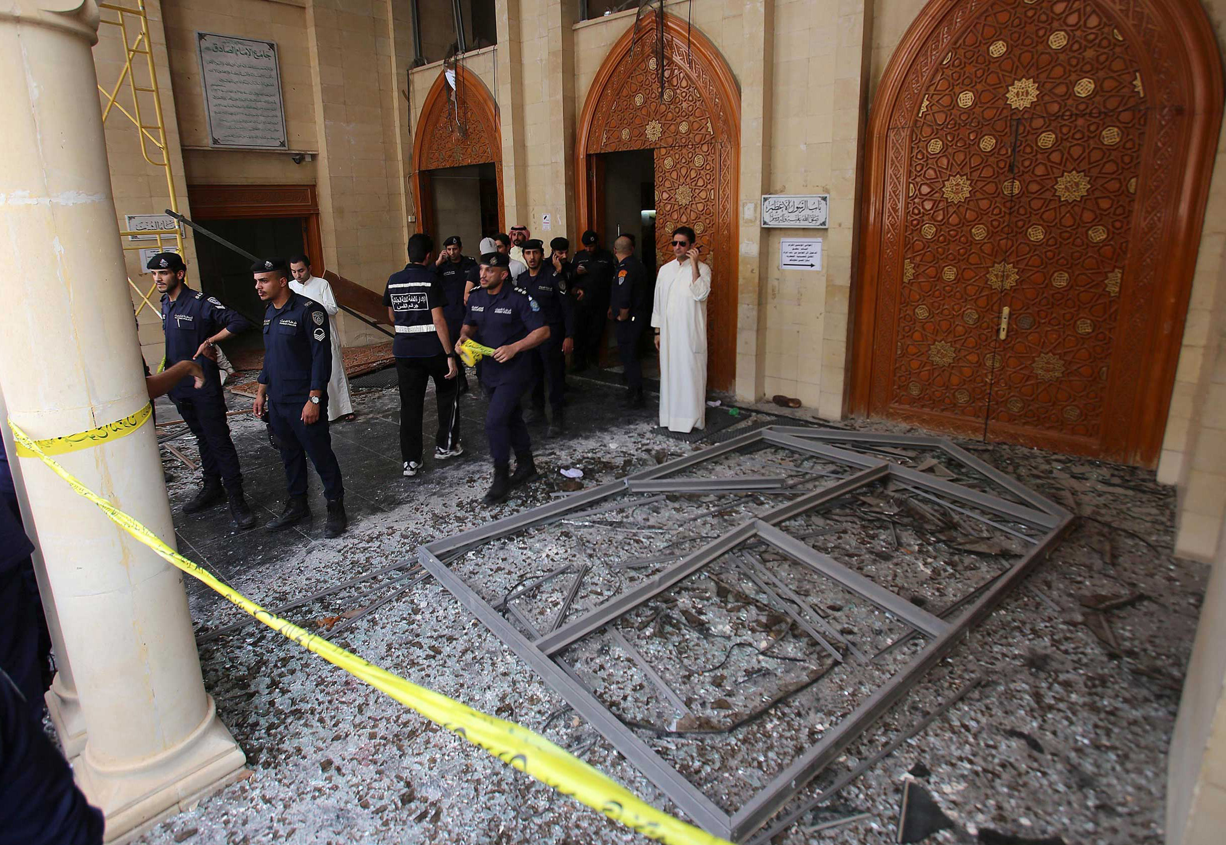 Kuwaiti security forces gather outside the Shii'te Al-Imam al-Sadeq mosque after it was targeted by a suicide bombing during Friday prayers in Kuwait City, on June 26, 2015,