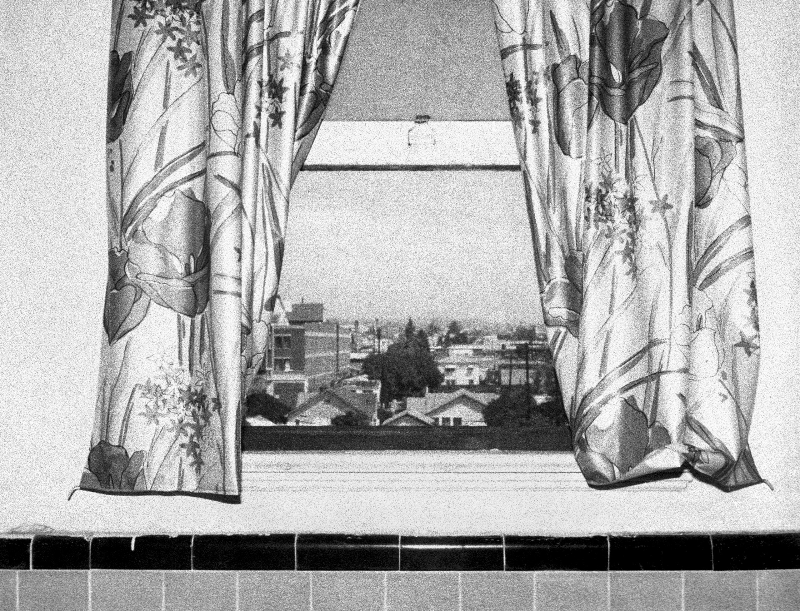 Window #13, from  The Hollywood Suites , 1976.                                 This image is from a project that explored inside/outside experience using anonymous, stripped down rooms in old Hollywood apartments as my working space. I photographed what I saw —Steve Kahn