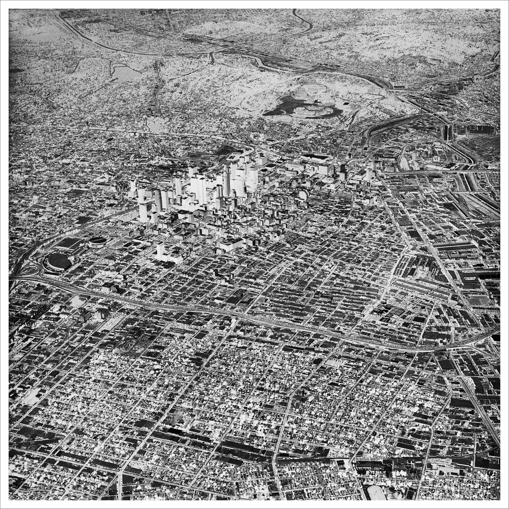Oblivion 10N, 2004.                                This image, Oblivion 10n, is from a series of aerial photographs of Los Angeles and its environs. I've reversed the tonalities, resulting in a negative version of the city, a kind of emptied out shadowland. Themes of development as a self-generating, self-replicating force that exists outside of nature are encoded in these images, which view Los Angeles as both a specific site and as a more generalized condition —David Maisel