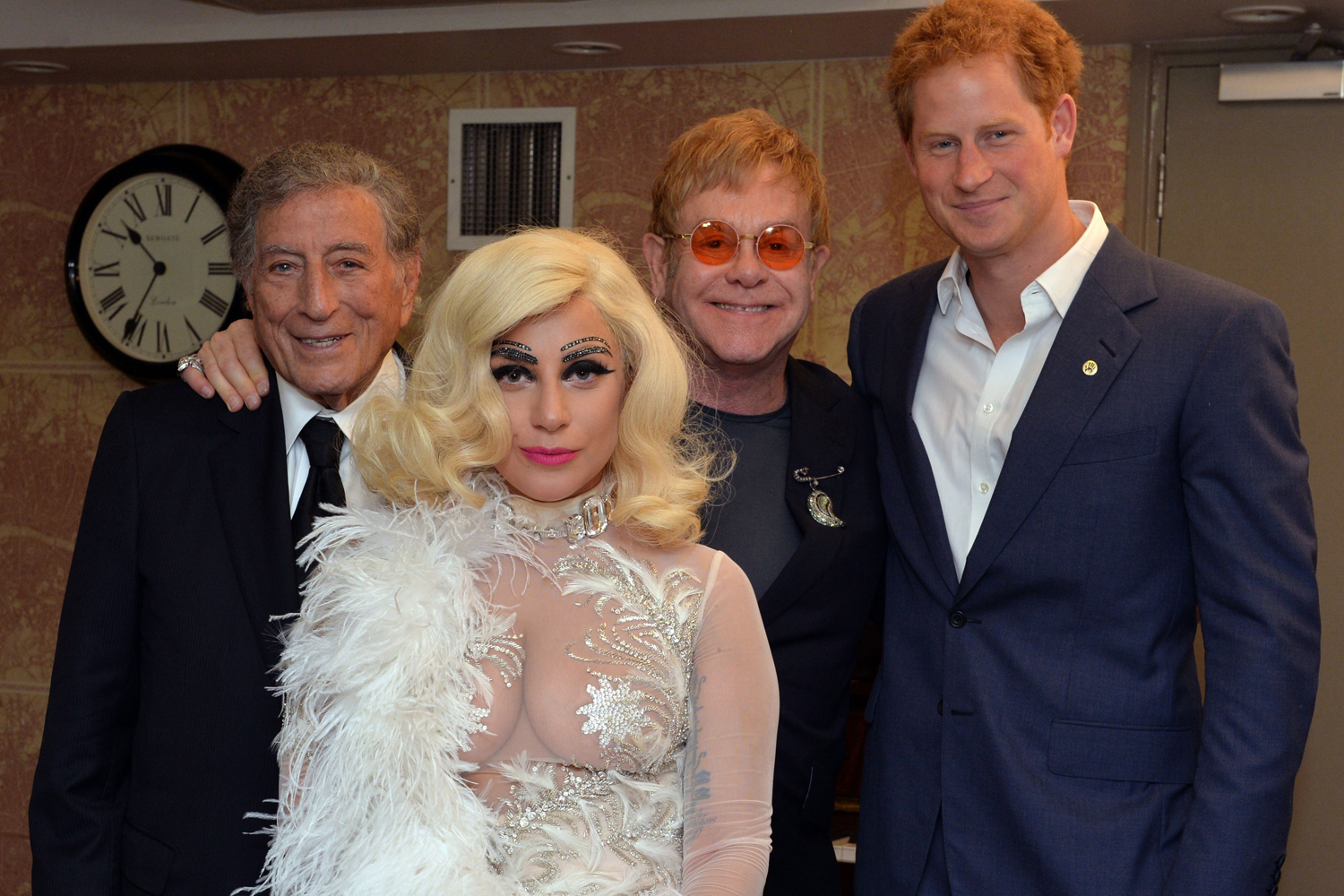 From right, Britain's Prince Harry, Elton John, Lady Gaga and Tony Bennett pose backstage for photographs after Bennett and Lady Gaga's performance as part of the Cheek to Cheek Tour at the Royal Albert Hall in London,  June 8, 2015