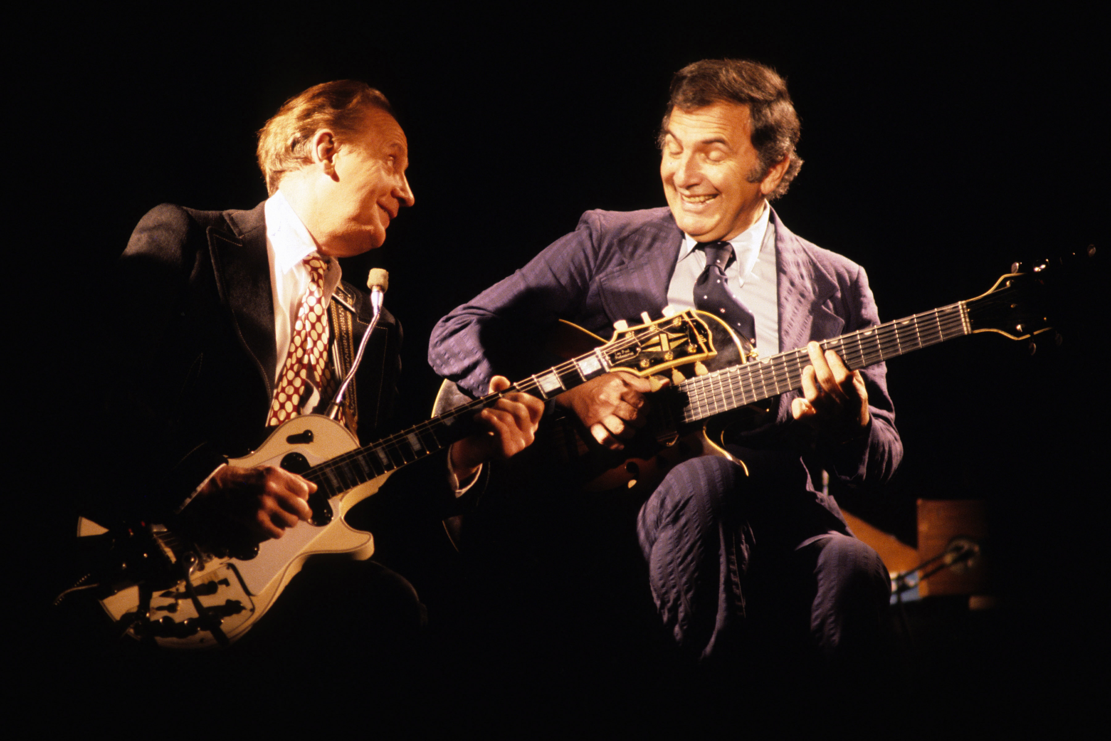 Paul shared a 1976 Grammy with Chet Atkins, shown above at right, for their album  Chester and Lester.