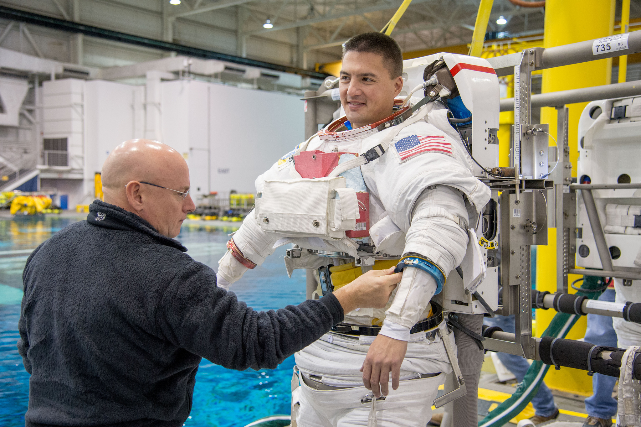Preparing to make a house call: Scott Kelly, currently aboard the space station for a one-year stay, checks out spacewalk suit of space doc Kjell Lindgren, who blasts off next month
