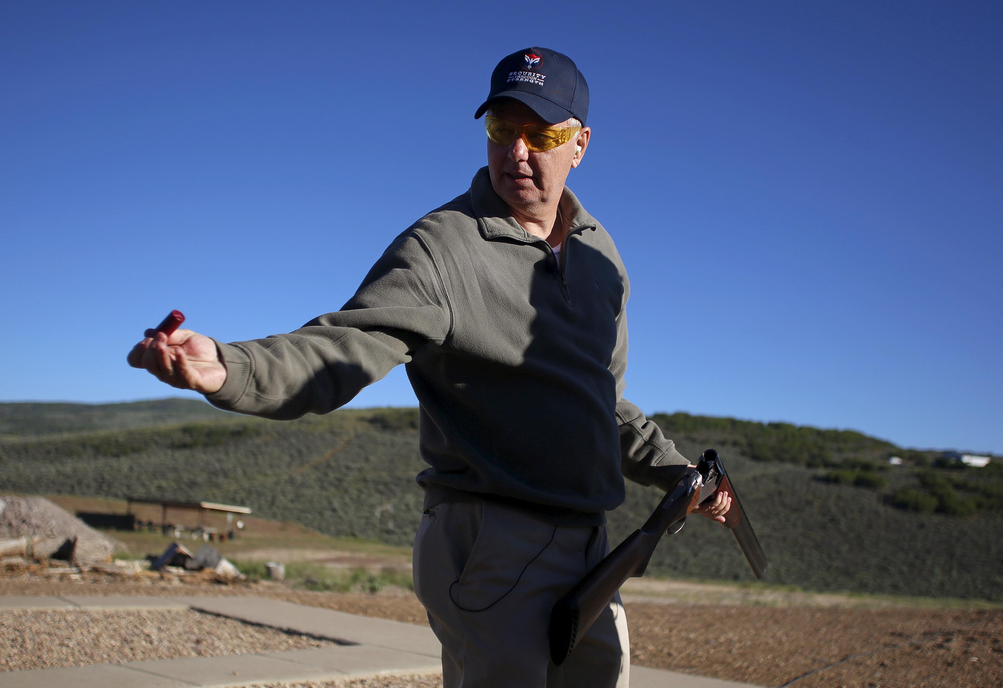 Republican presidential candidate U.S. Senator Lindsey Graham of South Carolina shoots skeet in Kamas, during a break at the E2 Summit held by former Republican presidential nominee Mitt Romney, at the Deer Valley Resort outside Park City, Utah.