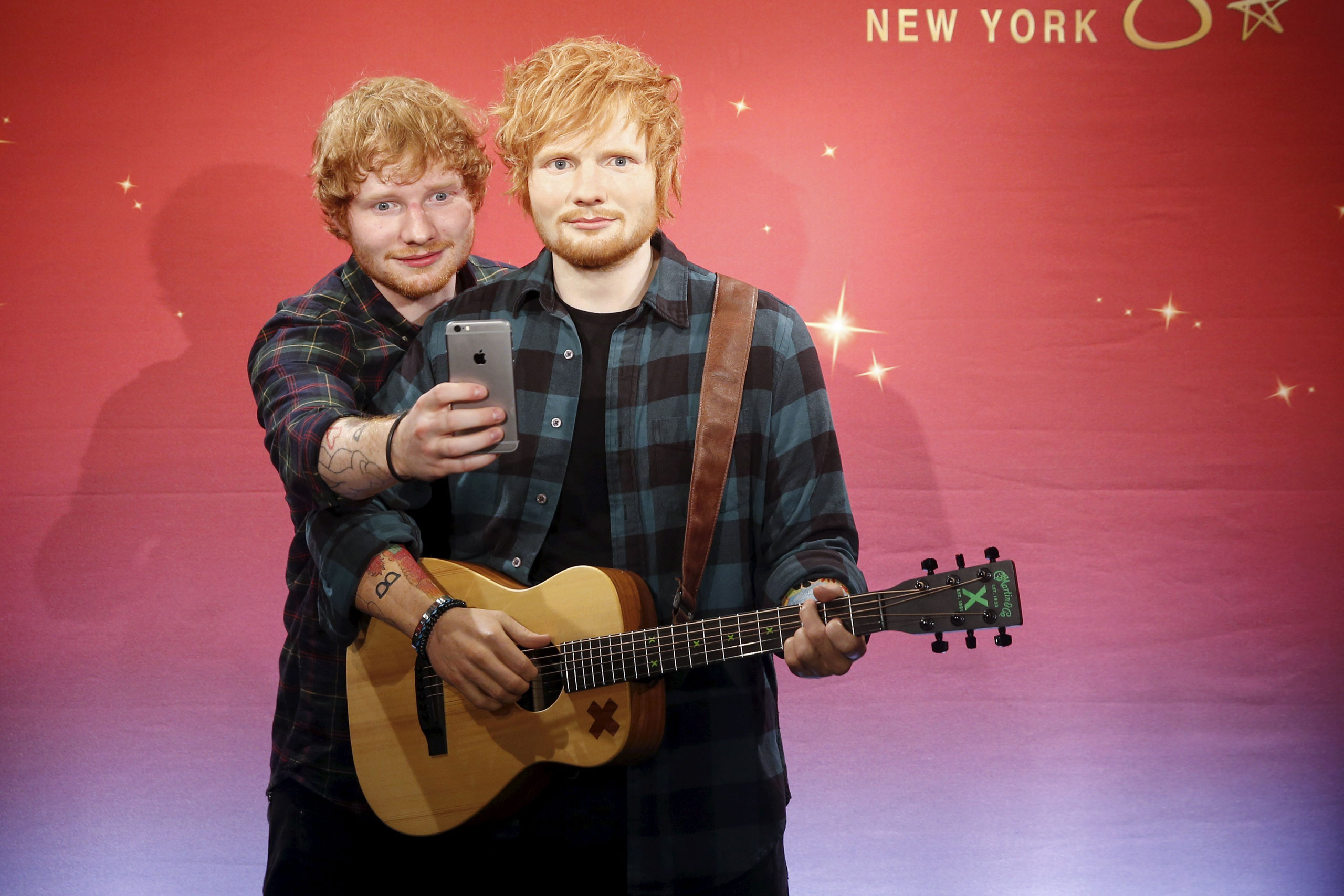 Ed Sheeran, left, takes a selfie with his wax figure at Madame Tussauds in New York on May 28, 2015.