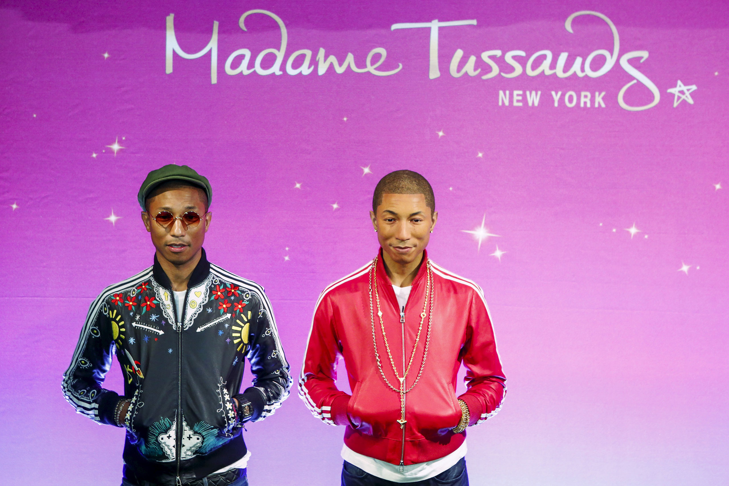 Pharrell Williams, left, poses next to his wax figure at Madame Tussauds in New York on  April 1, 2015.
