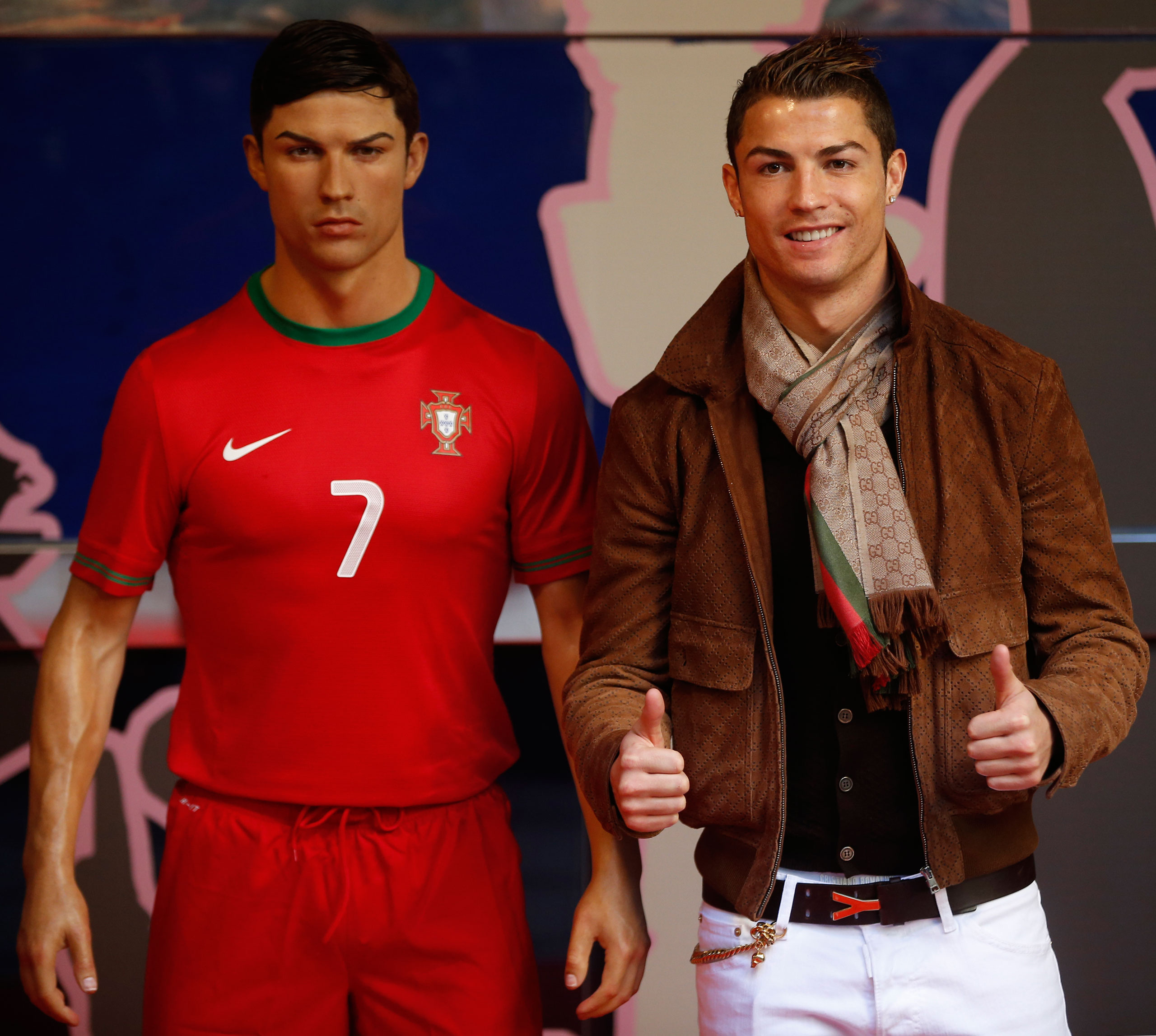 Cristiano Ronaldo, right, poses with his wax statue after an unveiling ceremony at the Madrid Wax Museum on Dec. 7, 2013.