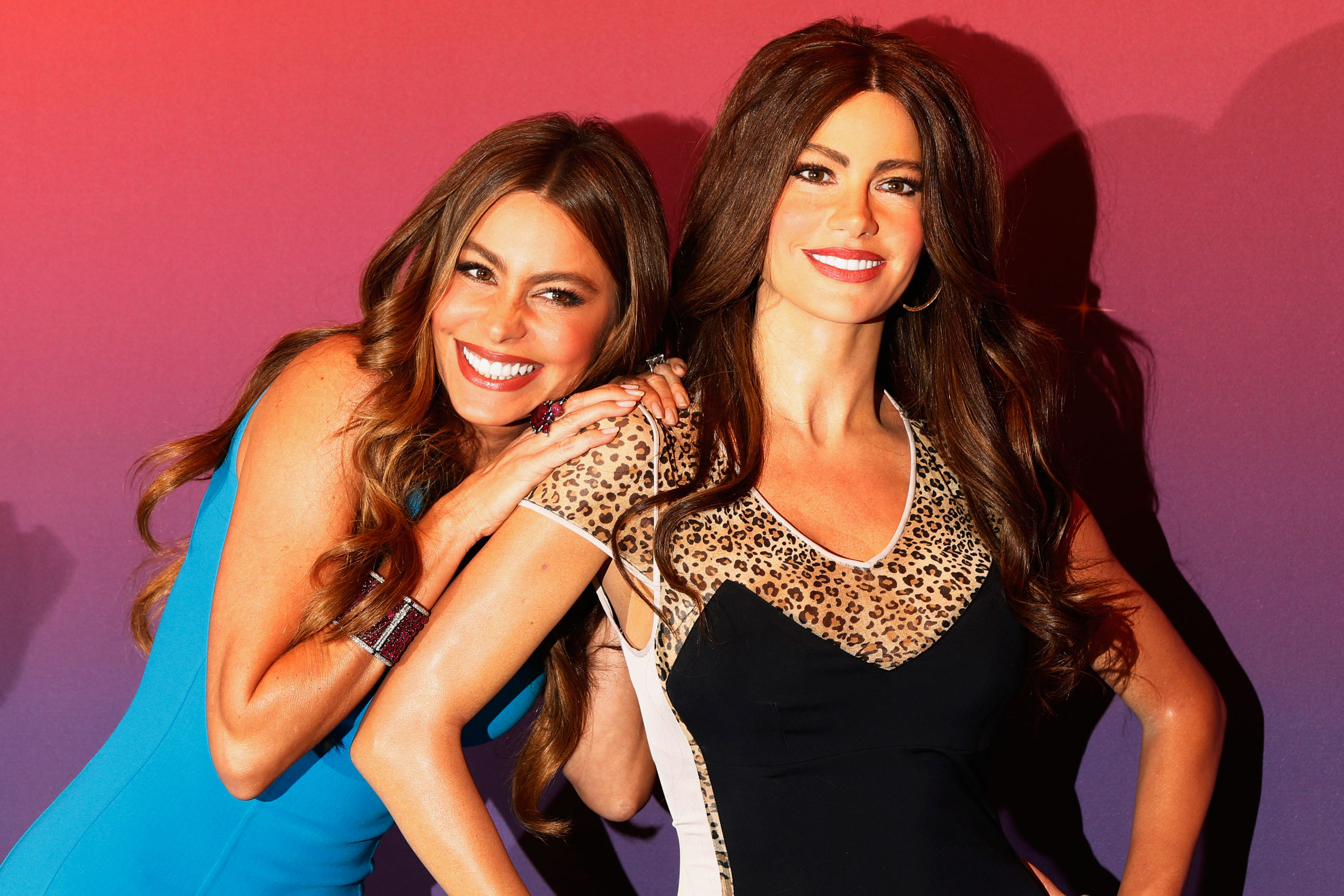 Sofia Vergara, left, poses with her wax figure during an unveiling at Madame Tussauds wax museum in New York on June 4, 2013.