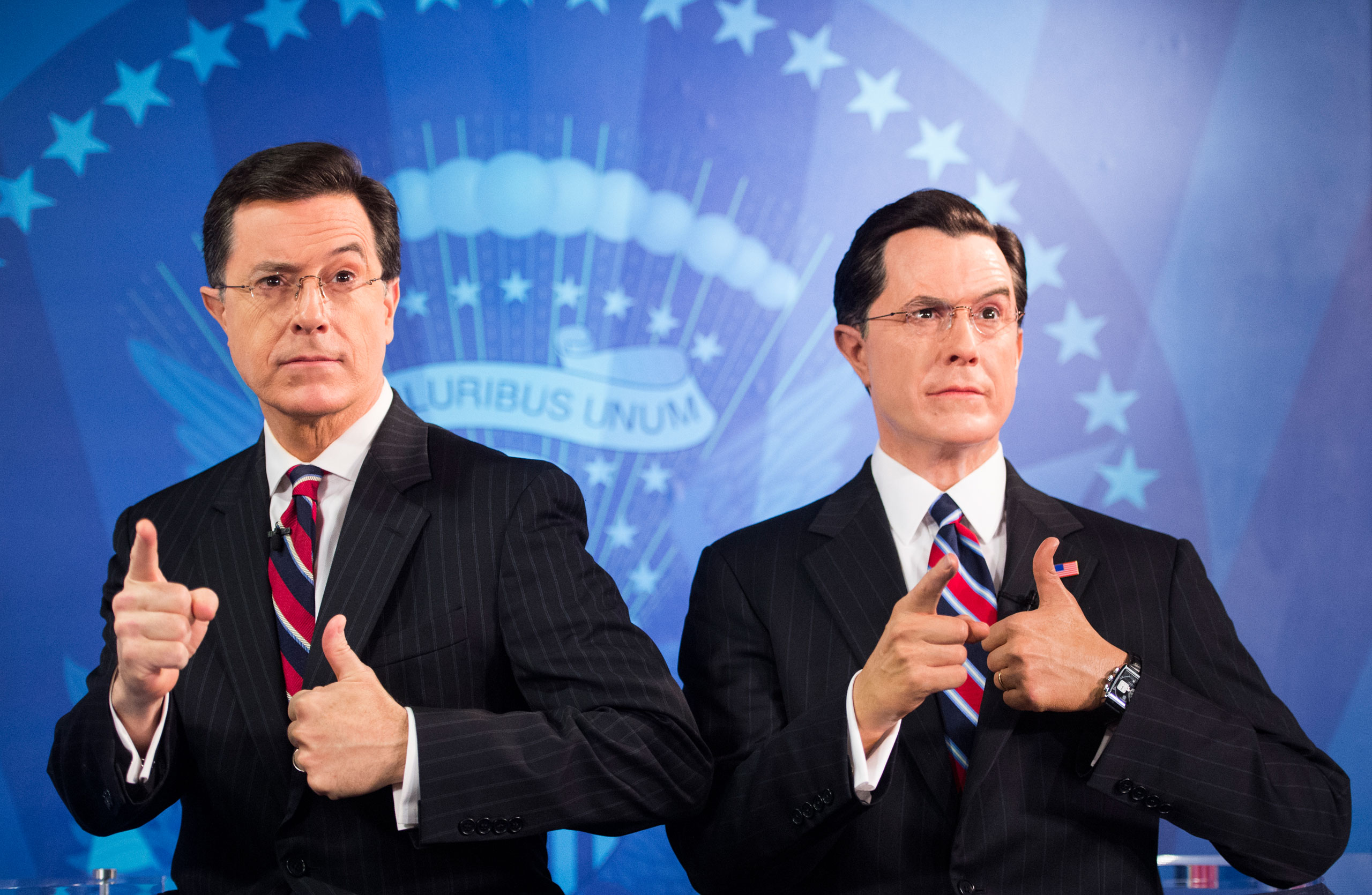 Stephen Colbert, left, poses with his wax figure at the Madame Tussauds wax museum in Washington on Nov. 16, 2012.