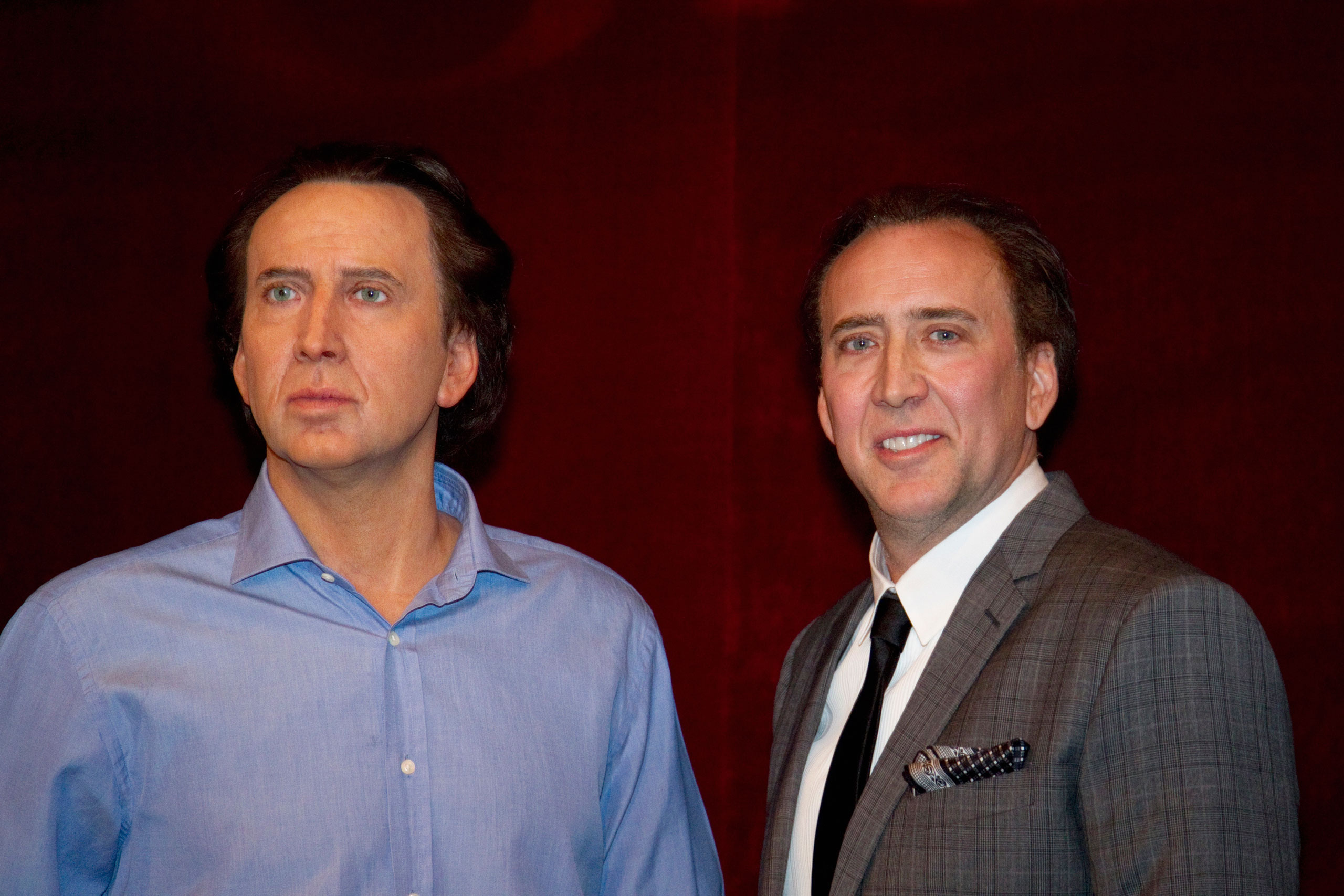 Nicolas Cage, right, stands next to his figure at the Grevin wax museum in Paris on  Jan. 29, 2012.