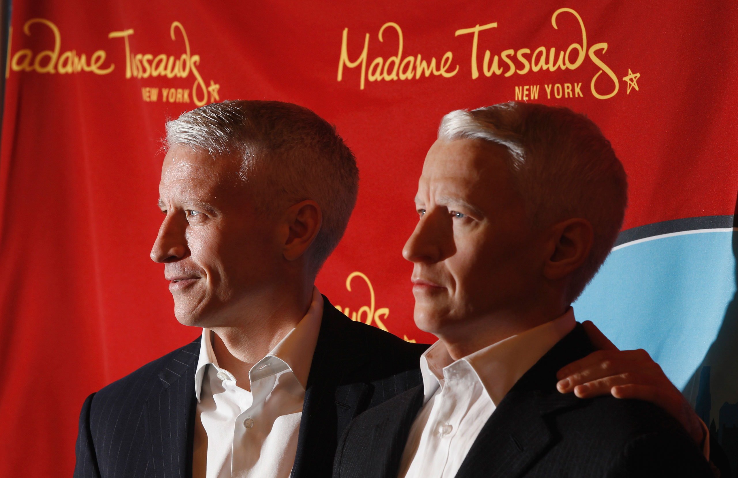 Anderson Cooper, left, poses with his wax figure as it is unveiled at Madame Tussauds on Sept. 14, 2011 in New York.