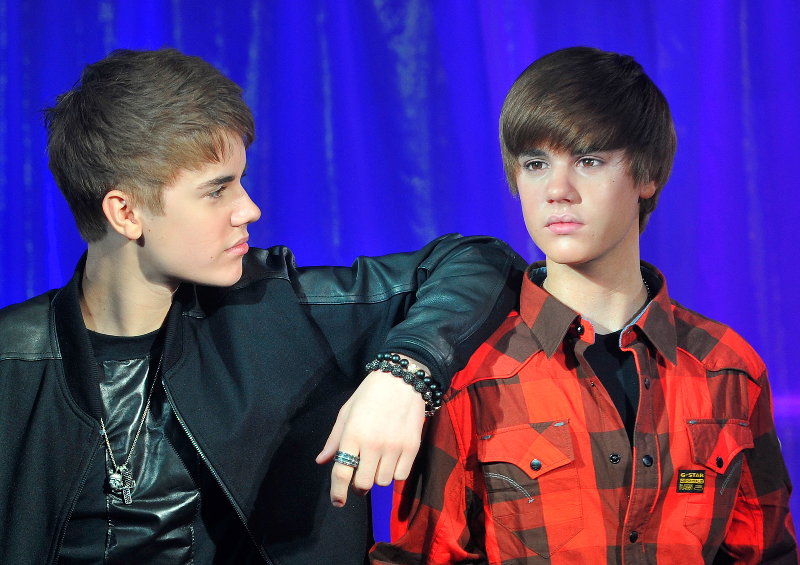 Justin Bieber, left, poses with his wax figure during an official unveiling at Madame Tussauds wax museum in London on March 15, 2011.