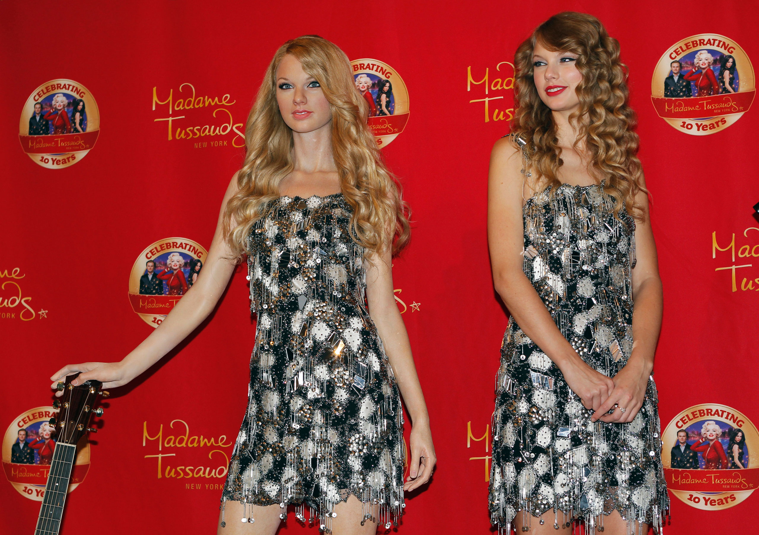 Taylor Swift, right, poses with her wax figure during an unveiling of her statue at Madame Tussauds in New York on  Oct. 27, 2010.