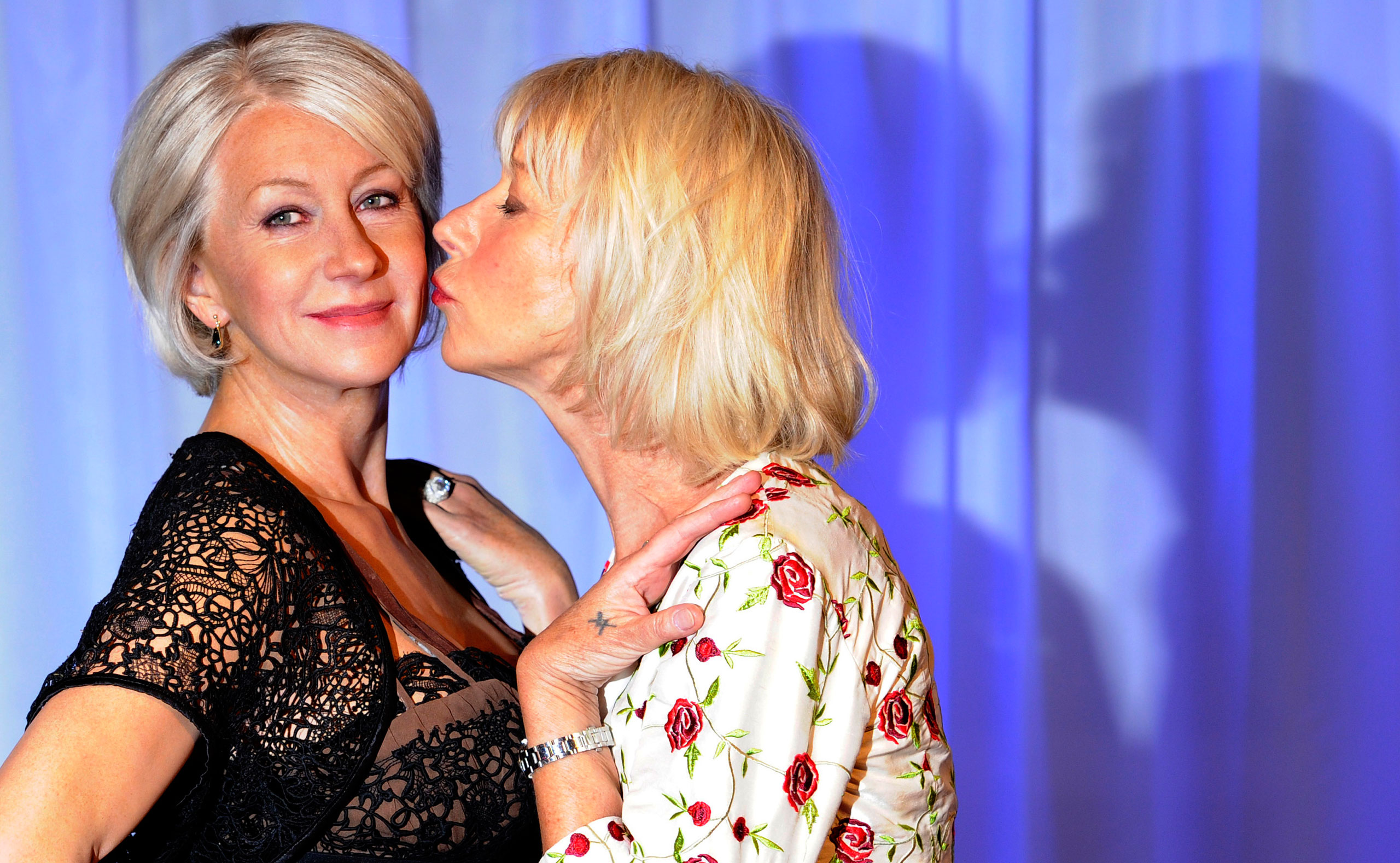 Helen Mirren, right, poses for photographers next to her wax model at Madame Tussauds in London on May 11, 2010.
