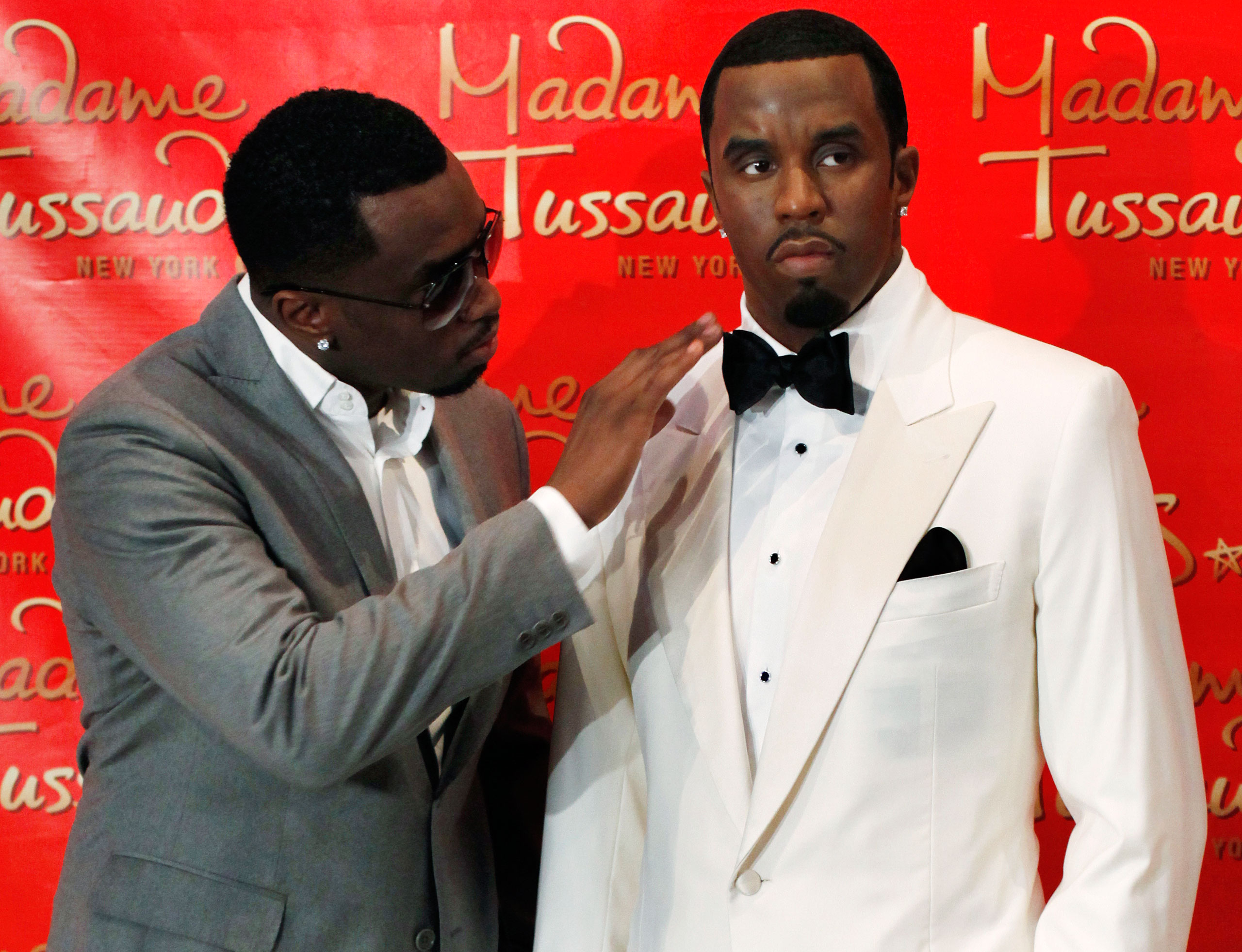 """Sean """"Diddy"""" Combs, left, touches his wax figure at Madame Tussauds in New York on Dec. 15, 2009."""