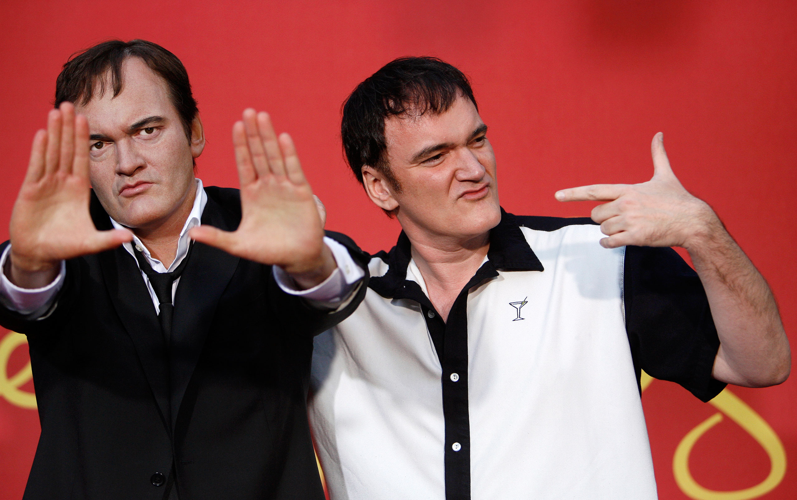 Quentin Tarantino, right, poses next to his wax figure after it was unveiled at Madame Tussauds in Hollywood on Aug. 7, 2009.