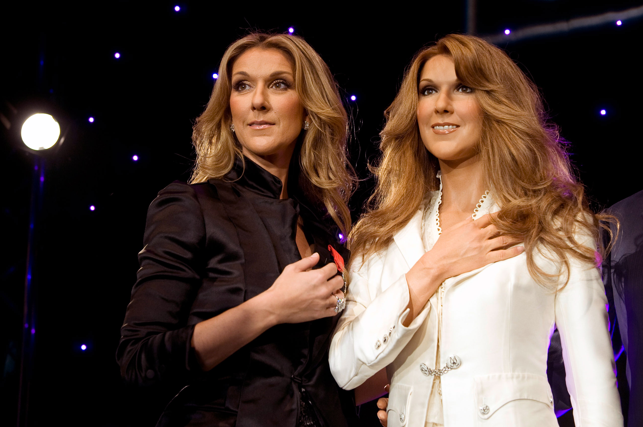 Singer Celine Dion, left, stands next to her figure at the Grevin wax museum in Paris on May 22, 2008.