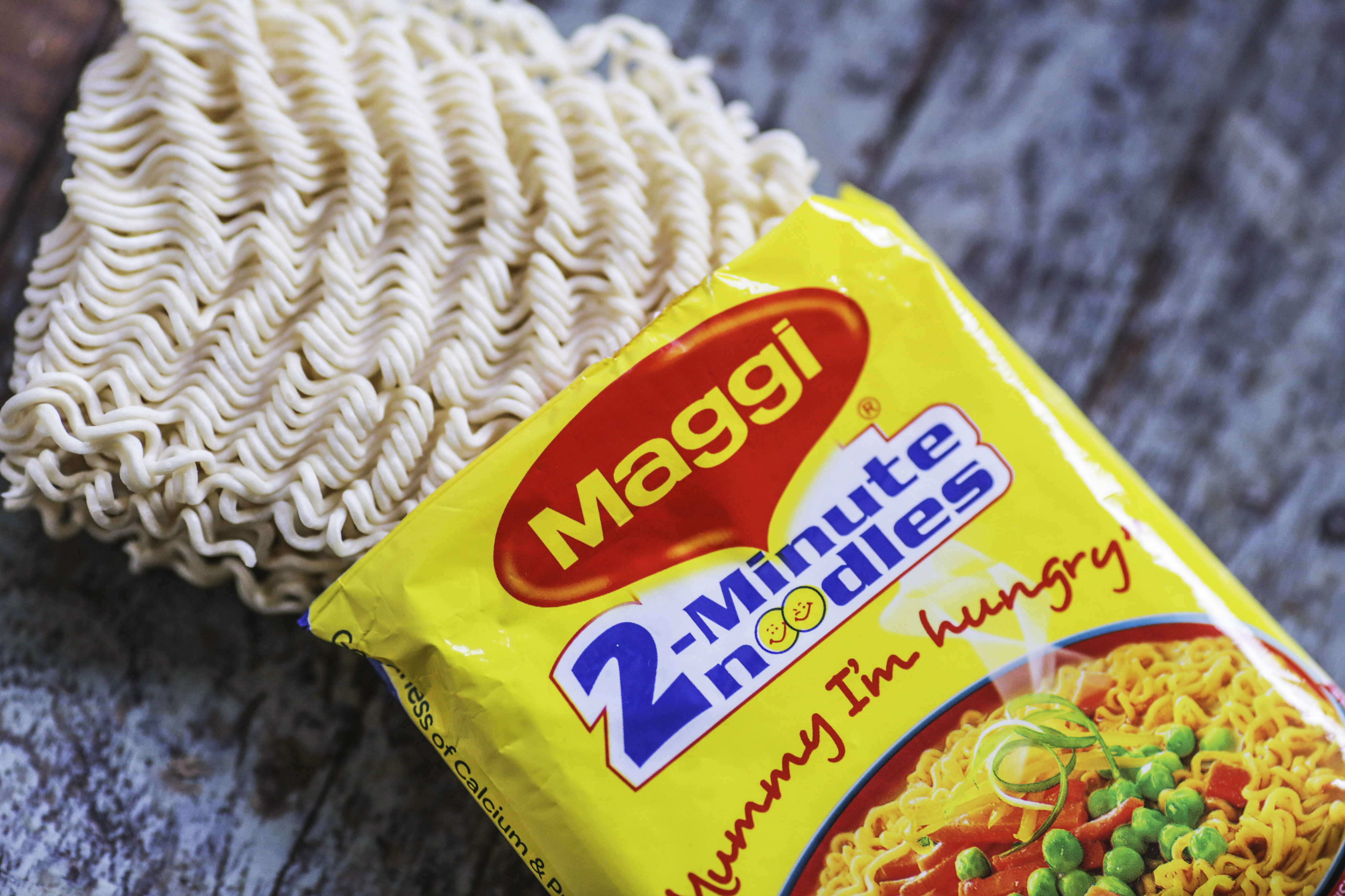 An open packet of Maggi 2-Minute Noodles, manufactured by Nestle India Ltd., are arranged for a photograph inside a general store in Mumbai, on June 2, 2015.