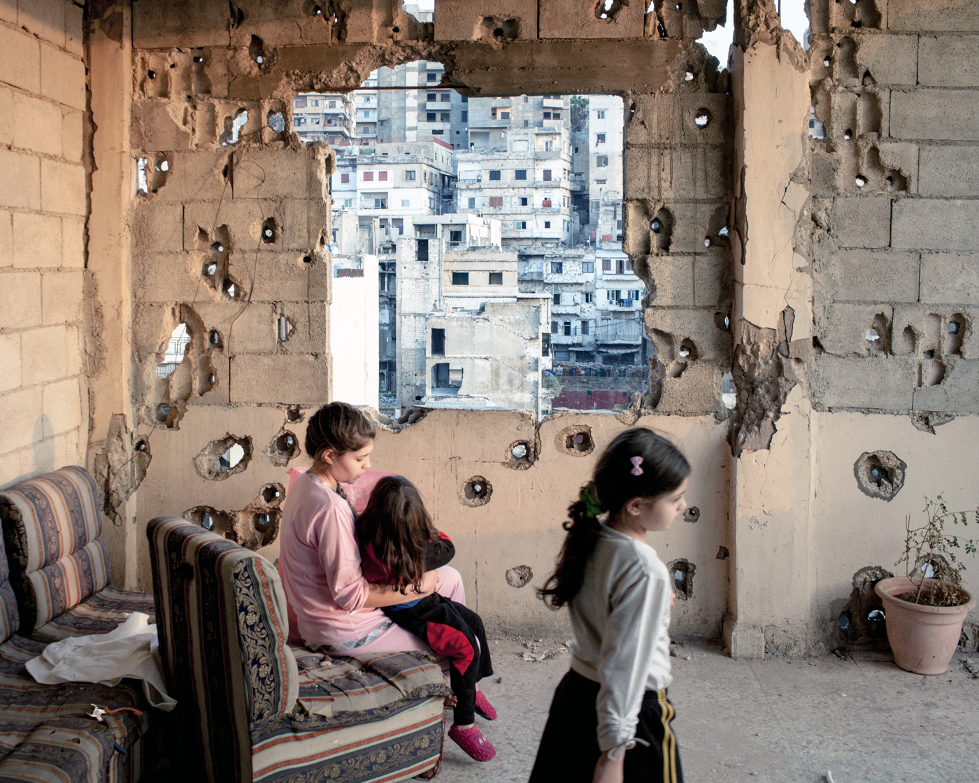 The interiors of an apartment on Syria streets destroyed by the fights between Sunnis and Shiite. Tripoli, Lebanon, Nov. 2013.
